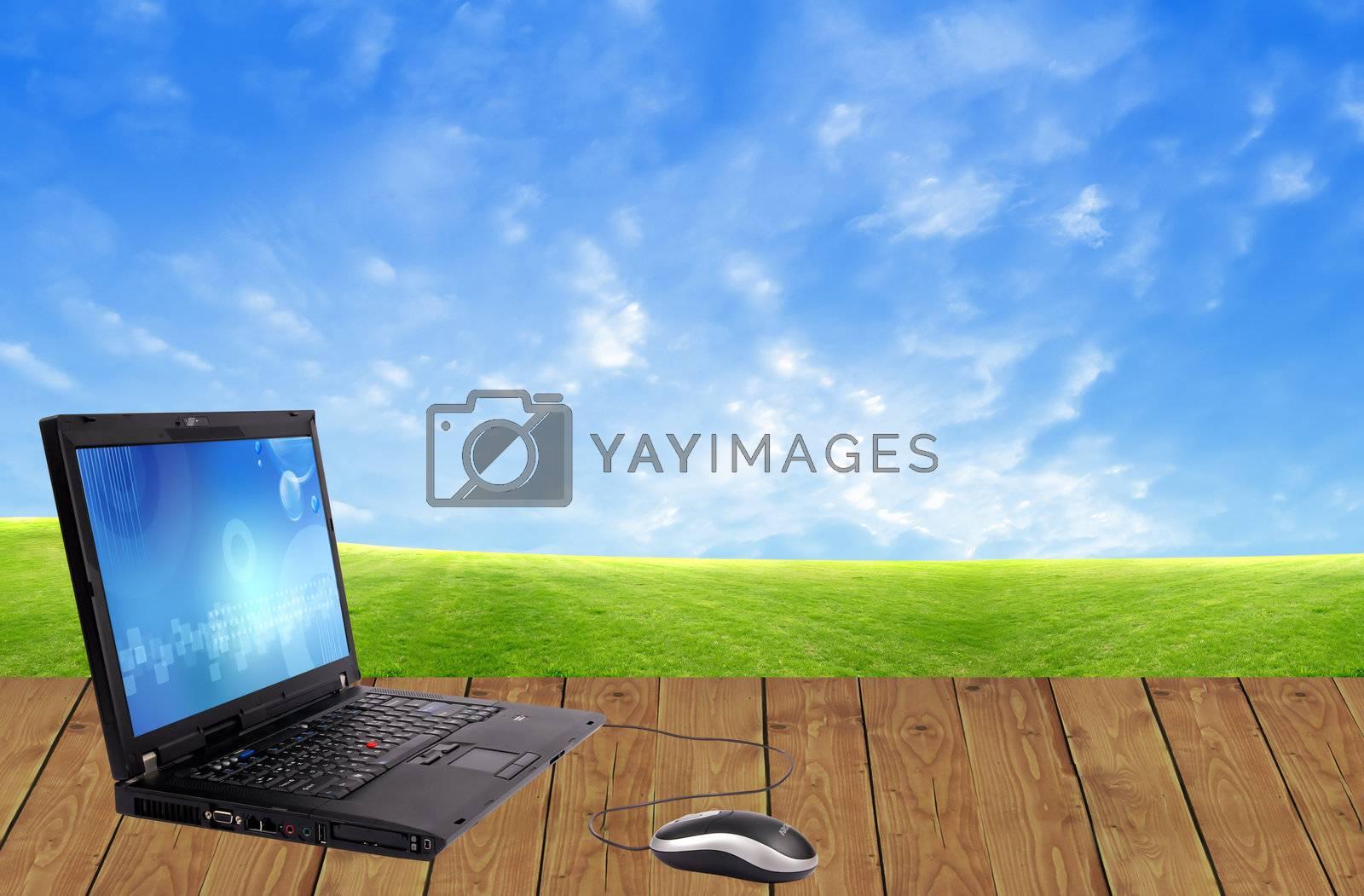Modern laptop on old wood