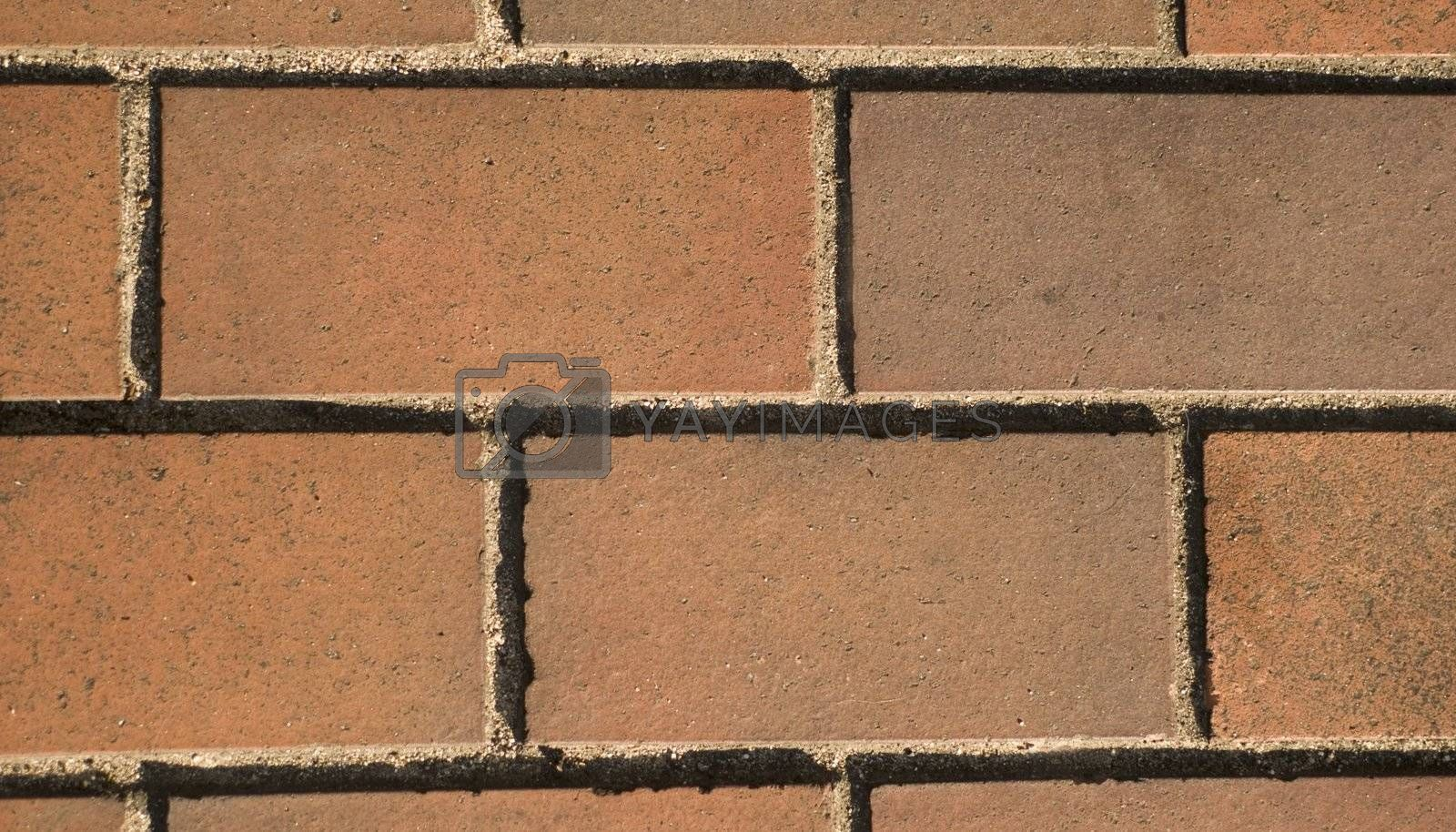 Optical illusion, simple brick pattern, clay rectangular tiles left to right. street in Nagoya, Japan.