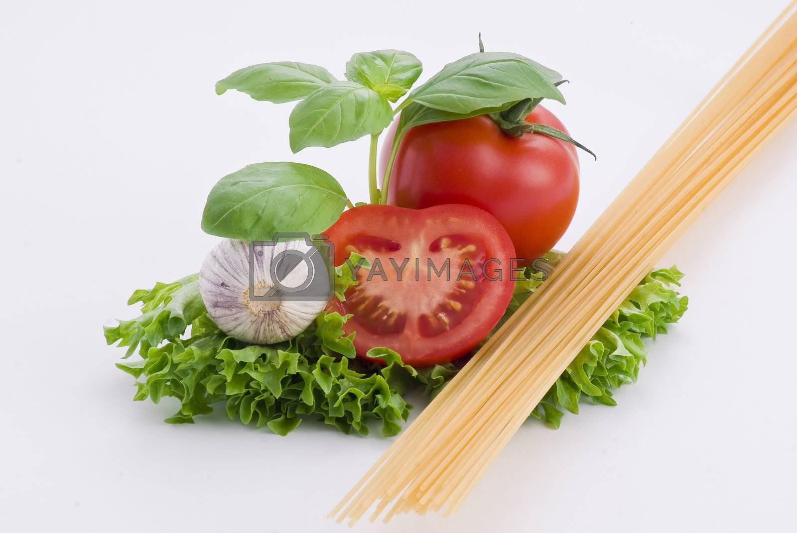 Pasta, tomatoes, basil and garlic by caldix