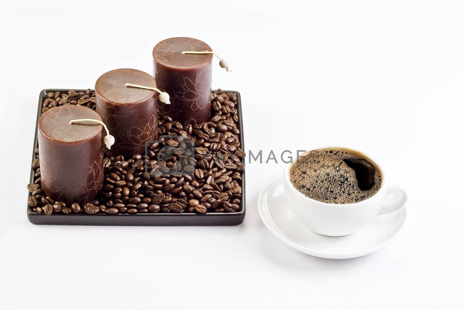 Cup of coffee with coffee beans and candles by caldix