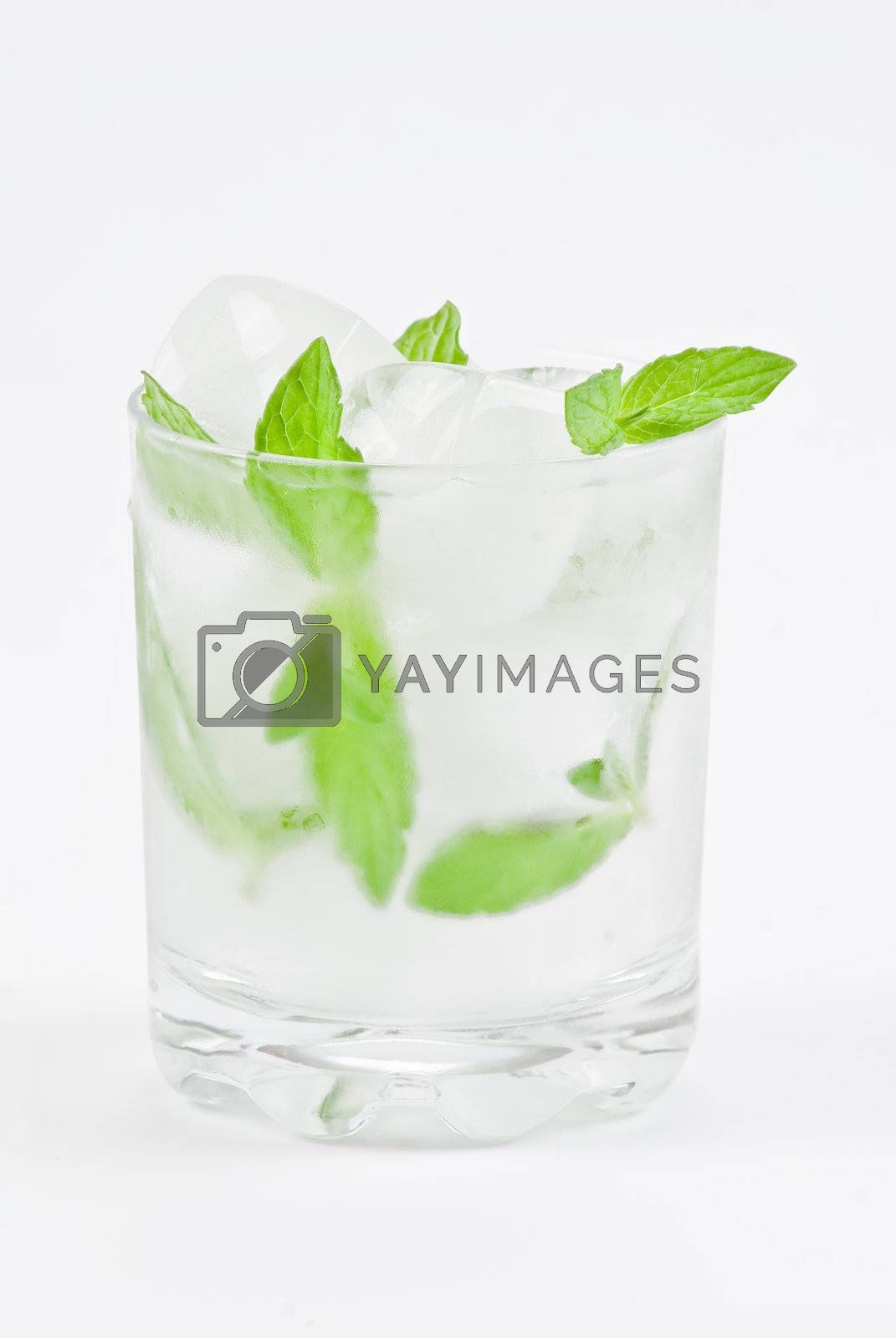 Glass of water with mint and ice by caldix