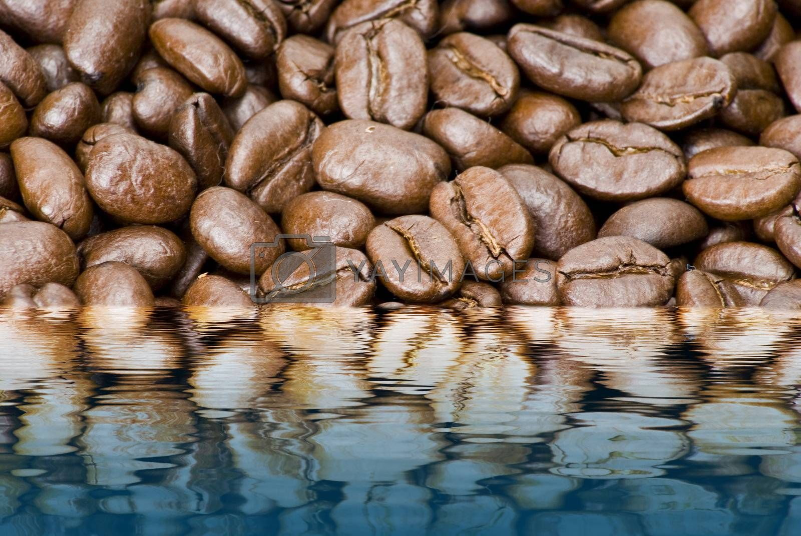 Coffe beans in water reflection by caldix