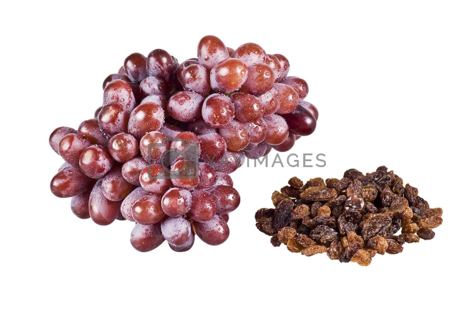 Bunch of grapes and raisins by caldix