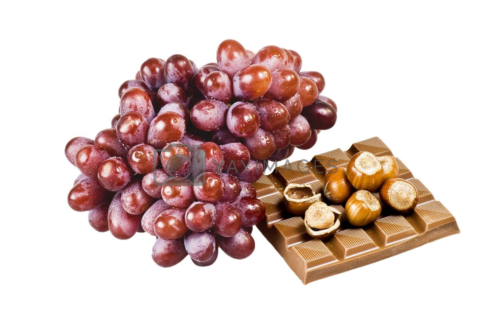 Chocolate, nuts and grapes by caldix