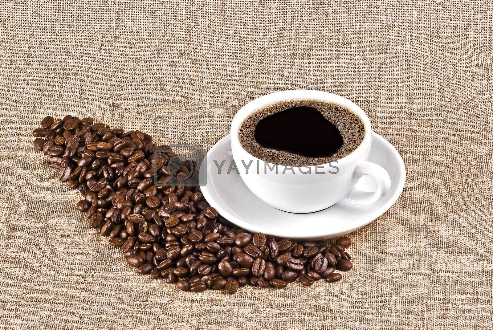 Cup of coffe and coffee beans by caldix