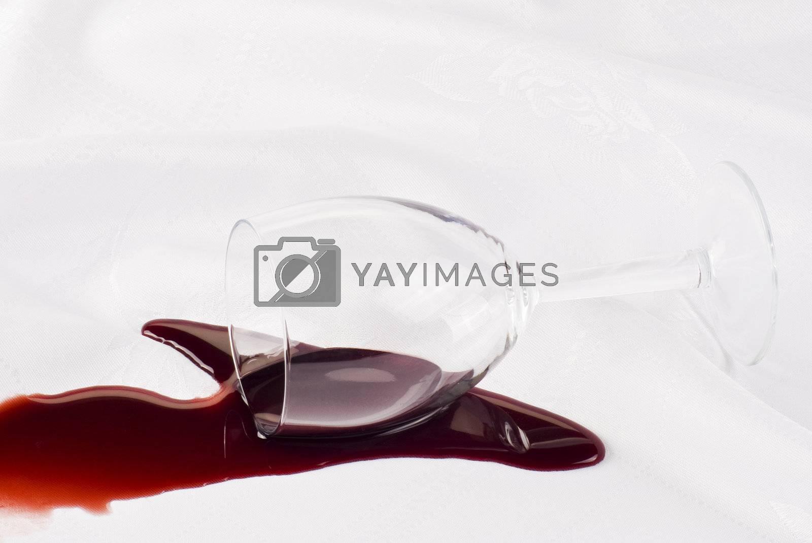 Overthrow glass of wine by caldix