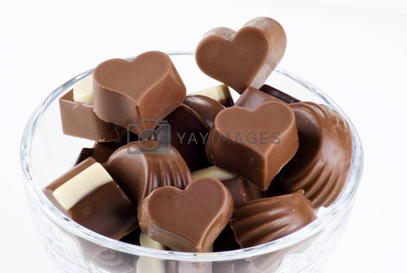 Glass bowl of chocolates  by caldix