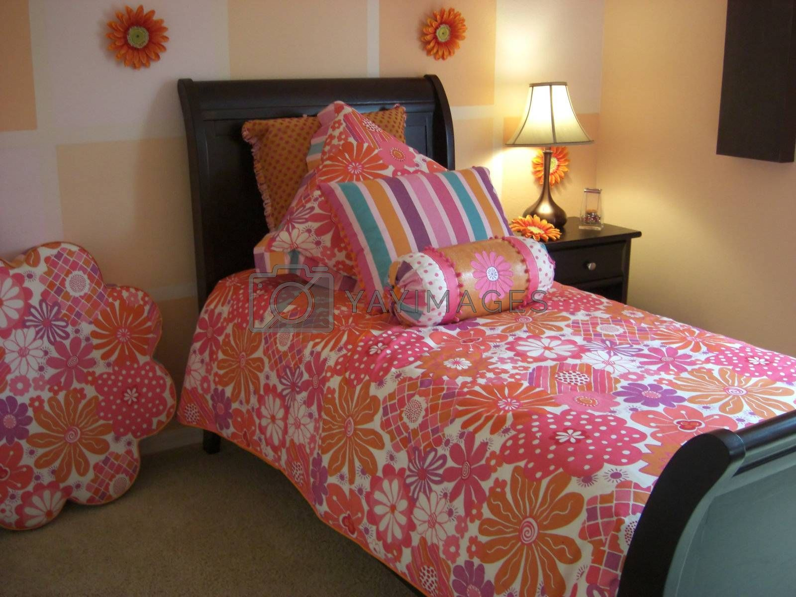 A bedroom is designed in a color coordination of pink.