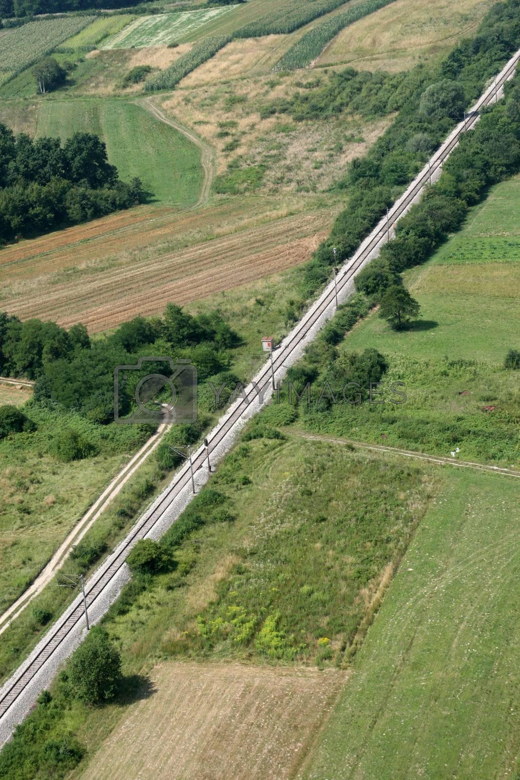 Railroad and green field