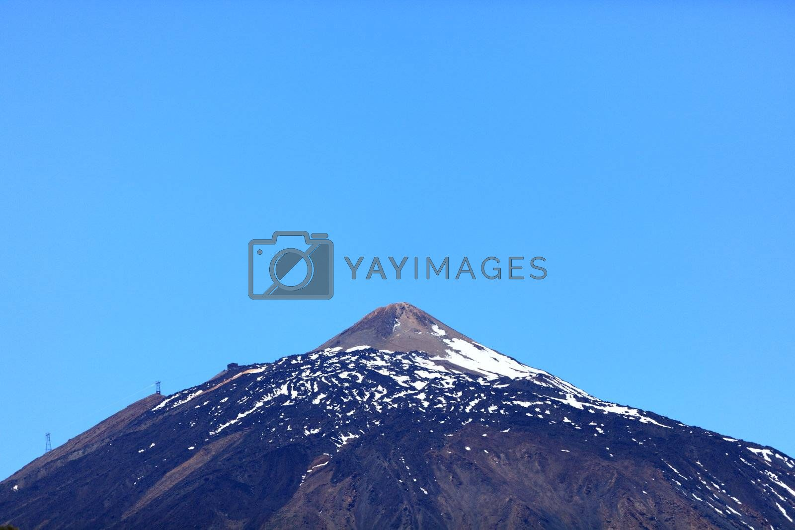 Teide mountain top. Pico del Teide - partly snow covered volcano peak photo from Tenerife during spring.