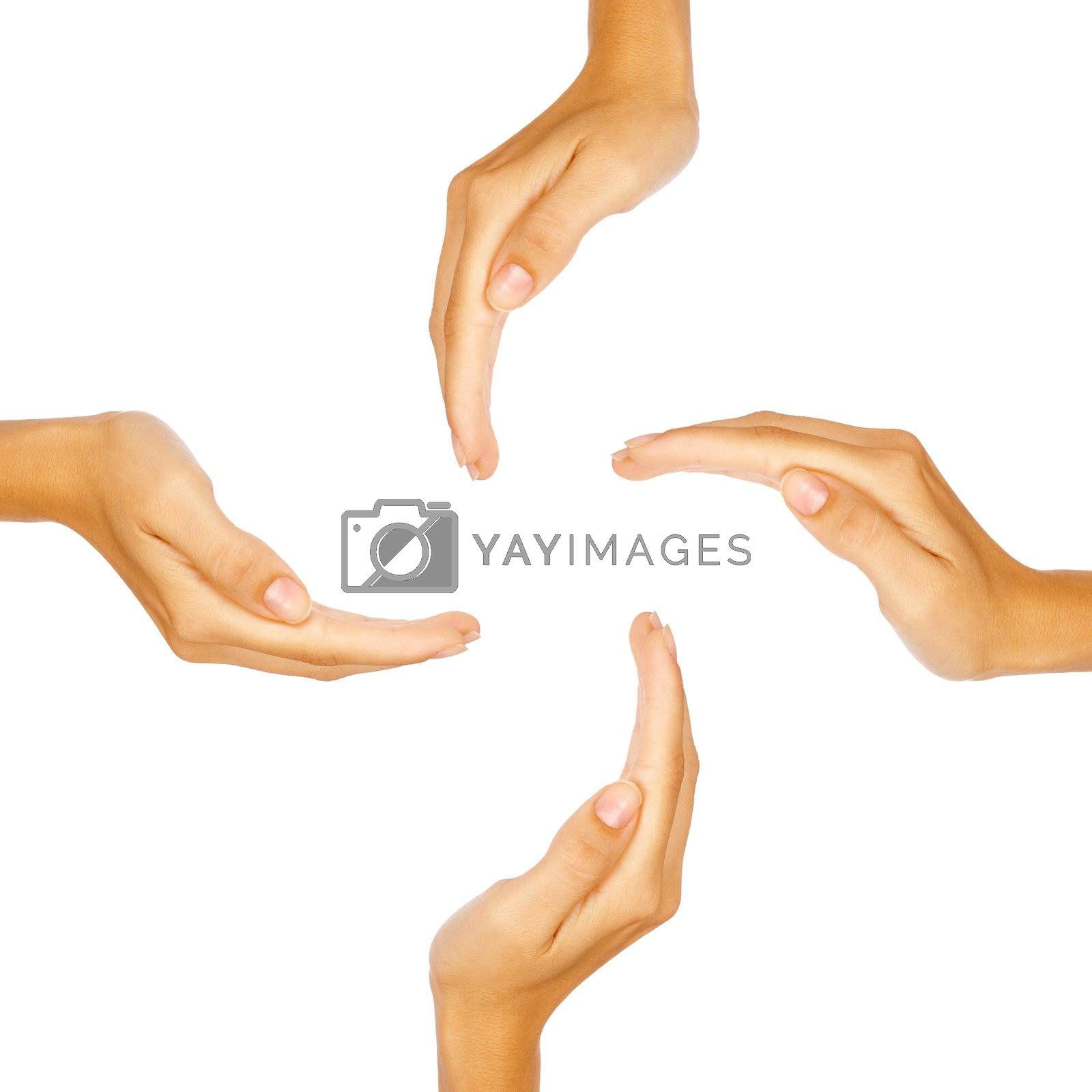Four human hands in circle preserving imaginary object or concept with copy-space isolated on white