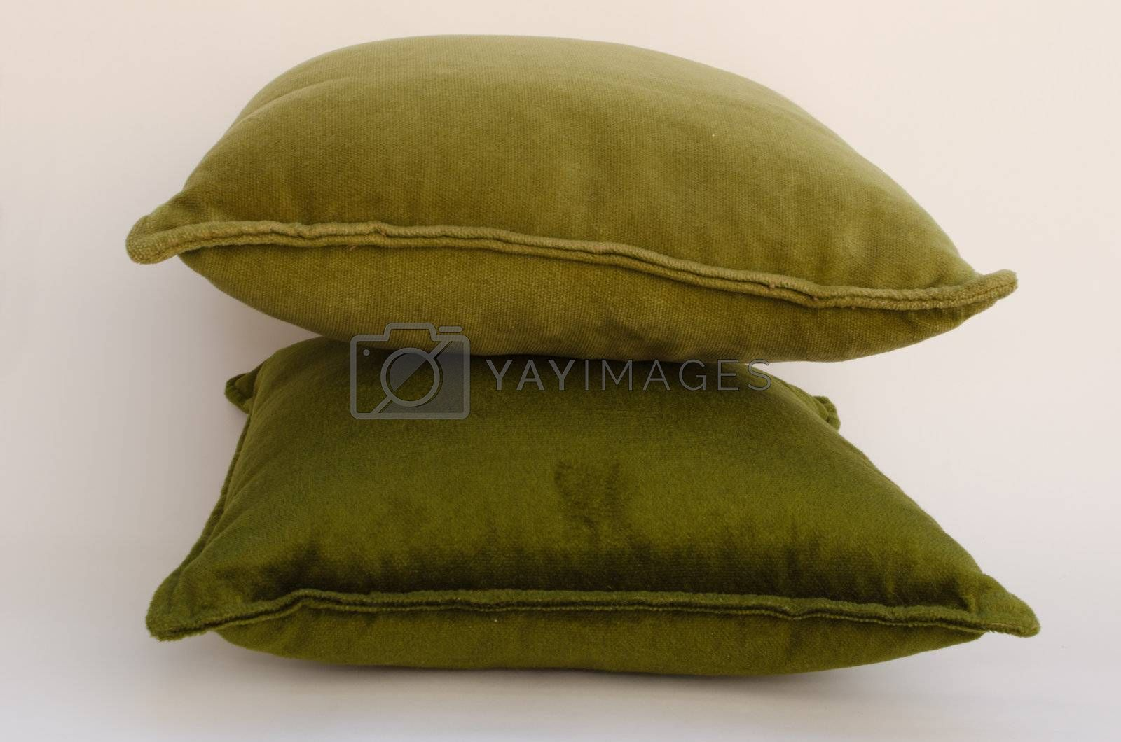 two green pillows isolated on white