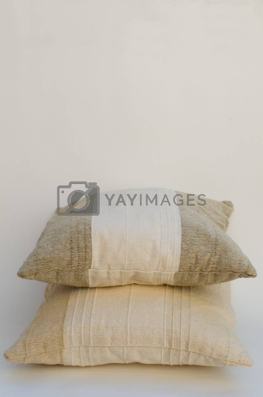 two beige pillows isolated on white