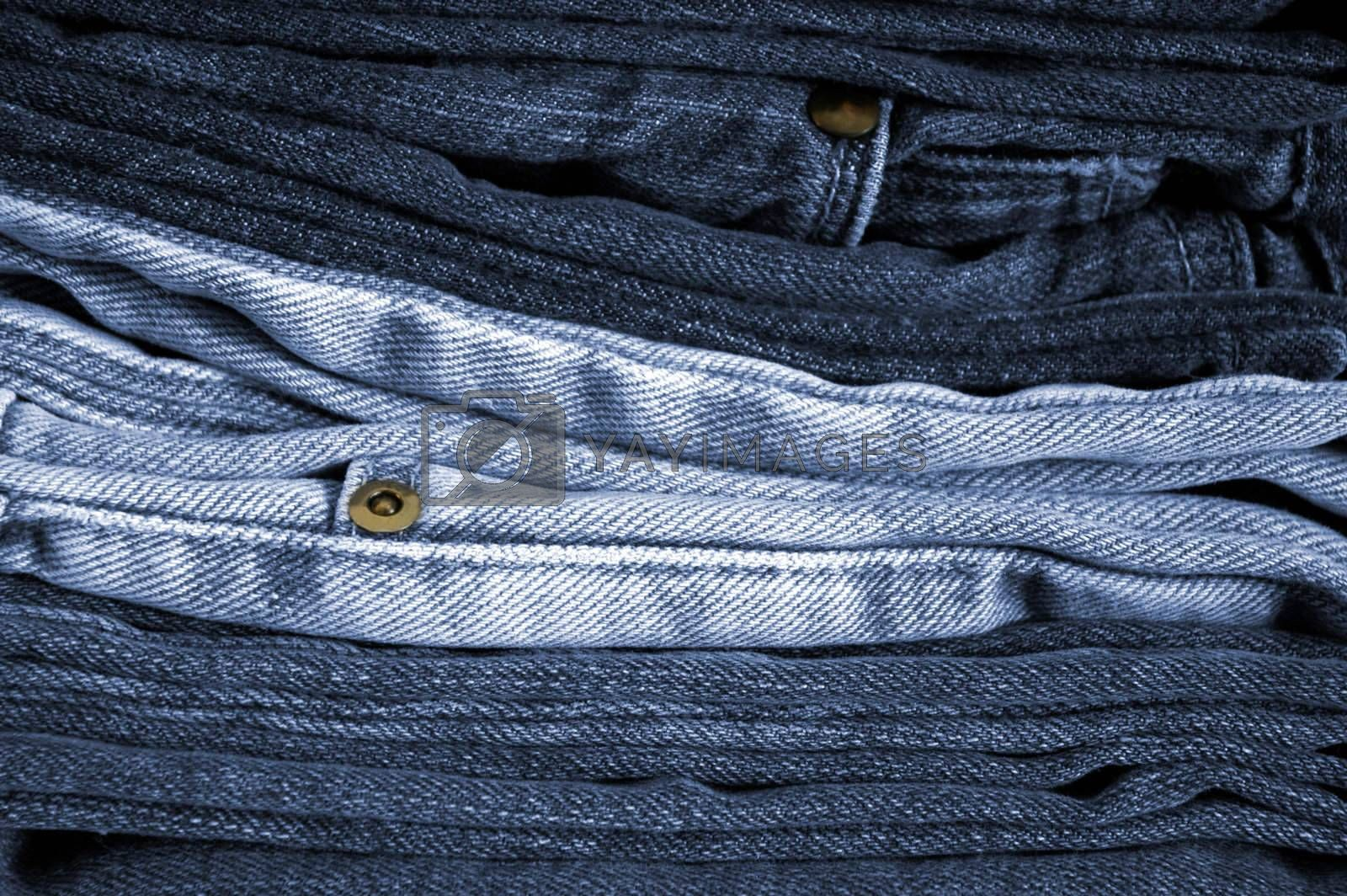 Close-up of stack of folded blue jeans.