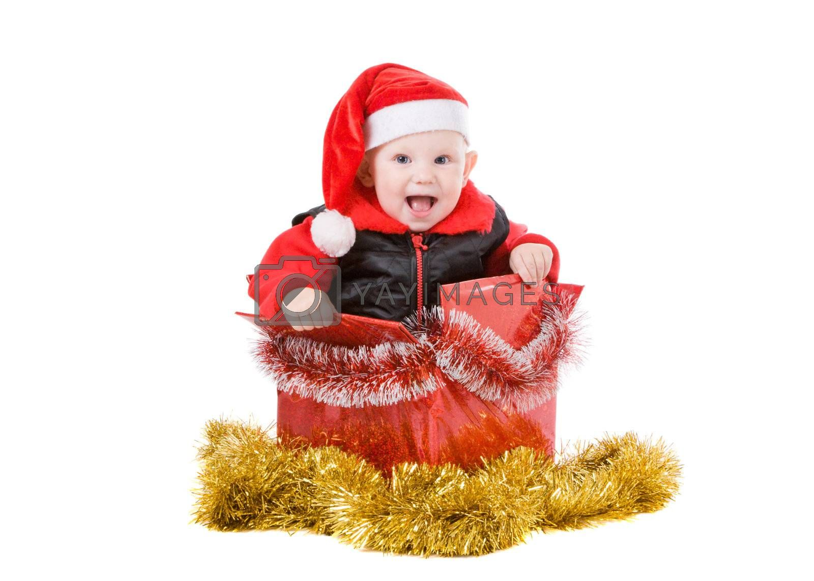 happy infant with red cap in a decorated christmas box