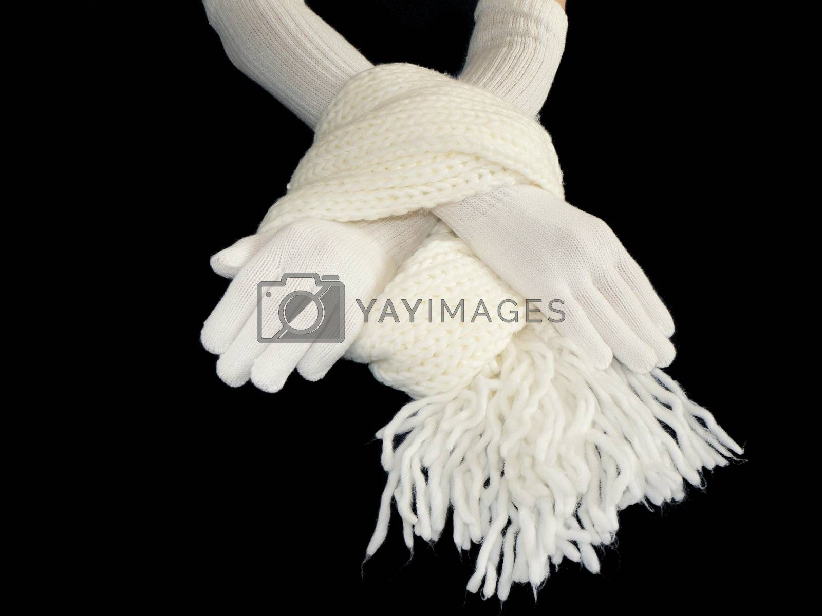 Hands in gloves and scarf on black background