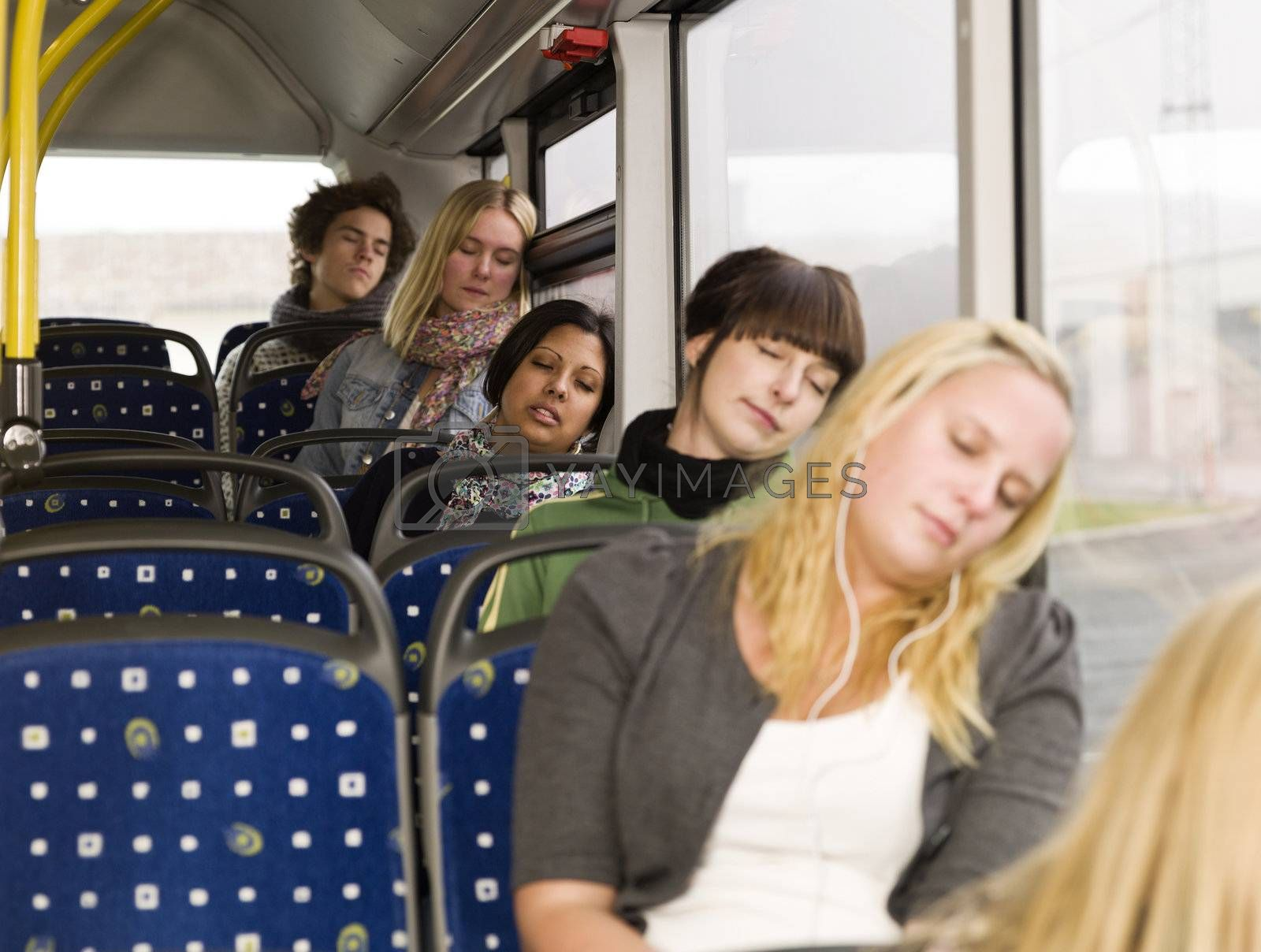 Group of young sleeping people on the bus