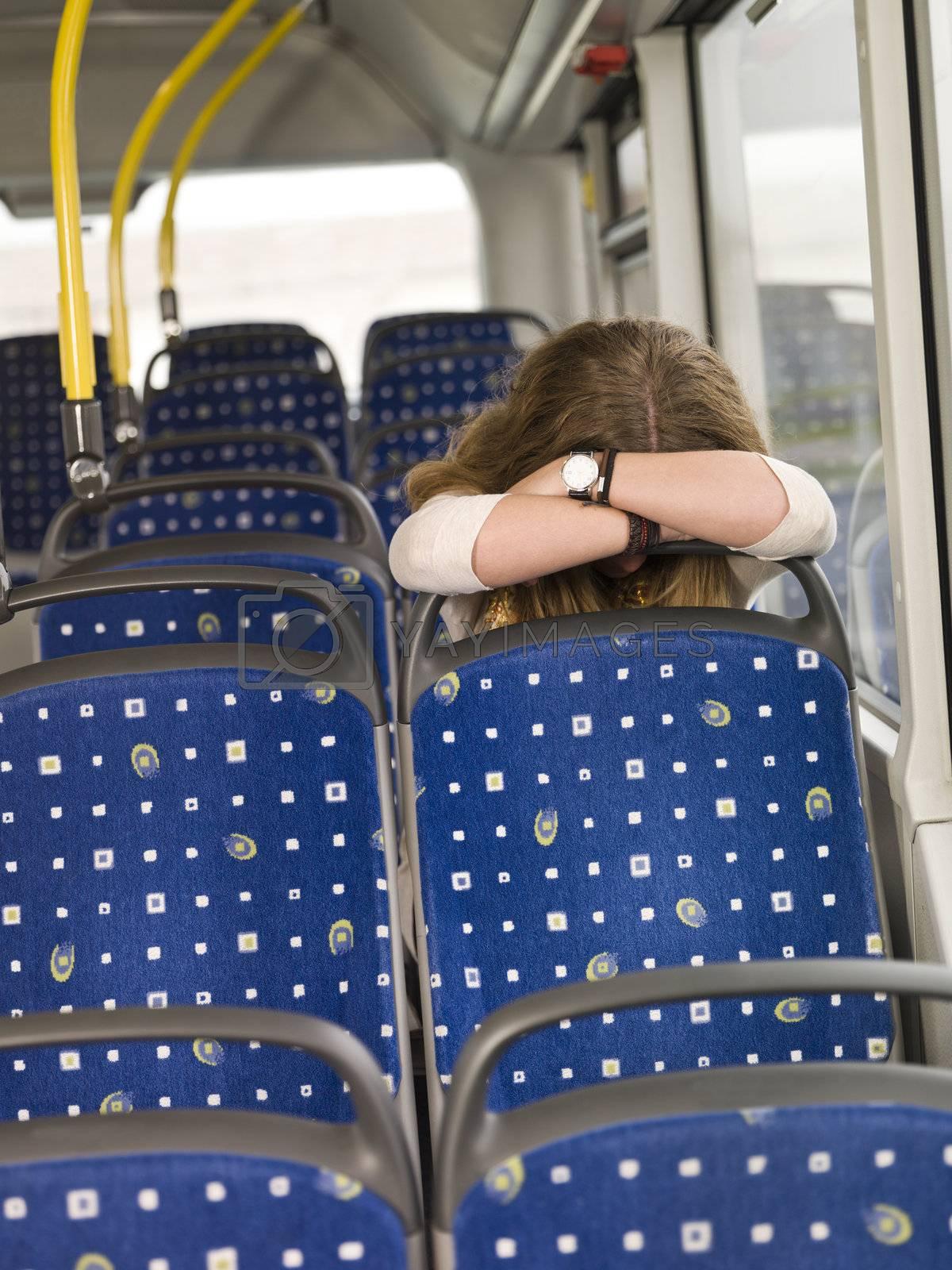 Sad woman alone on the bus