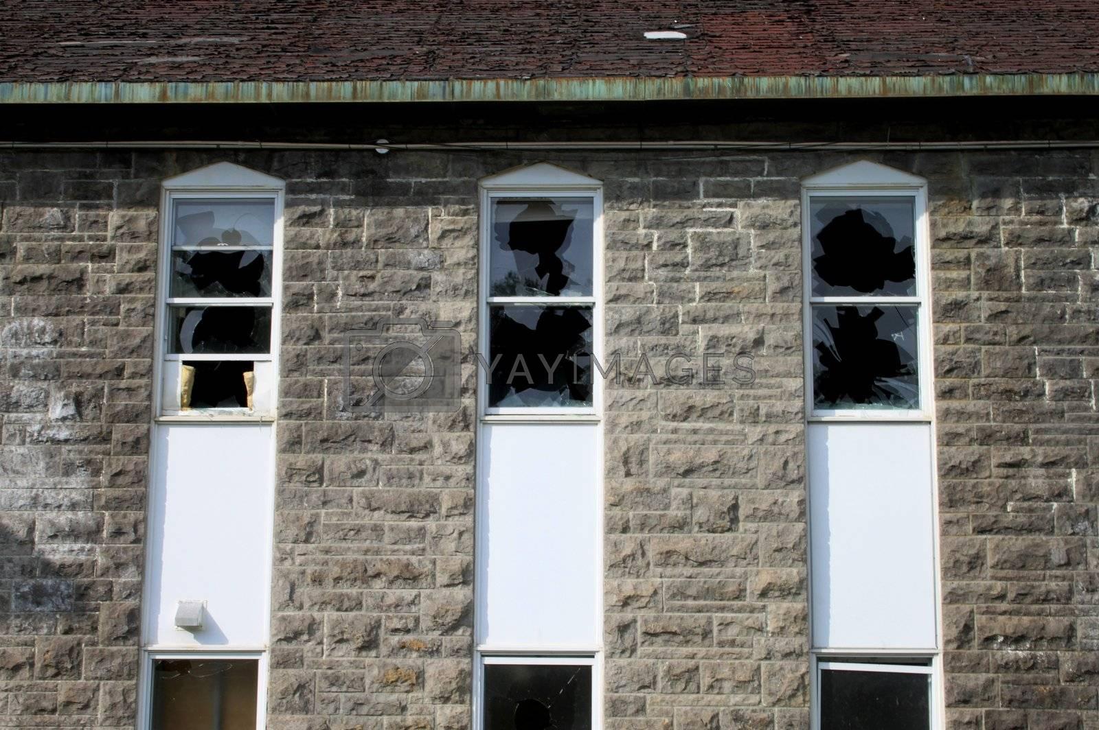 Broken windows by vandalism on historic building