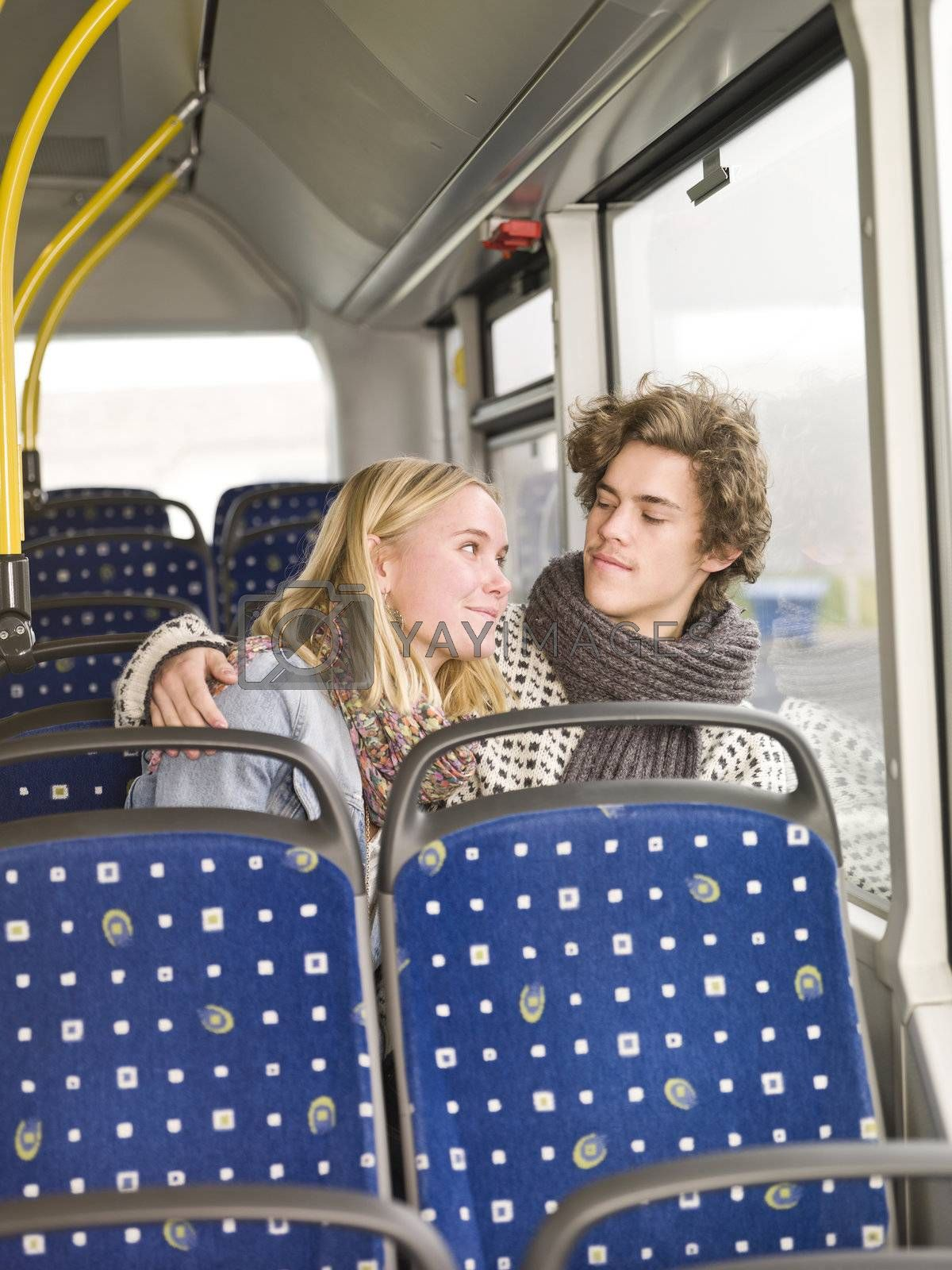 Young couple alone on the bus
