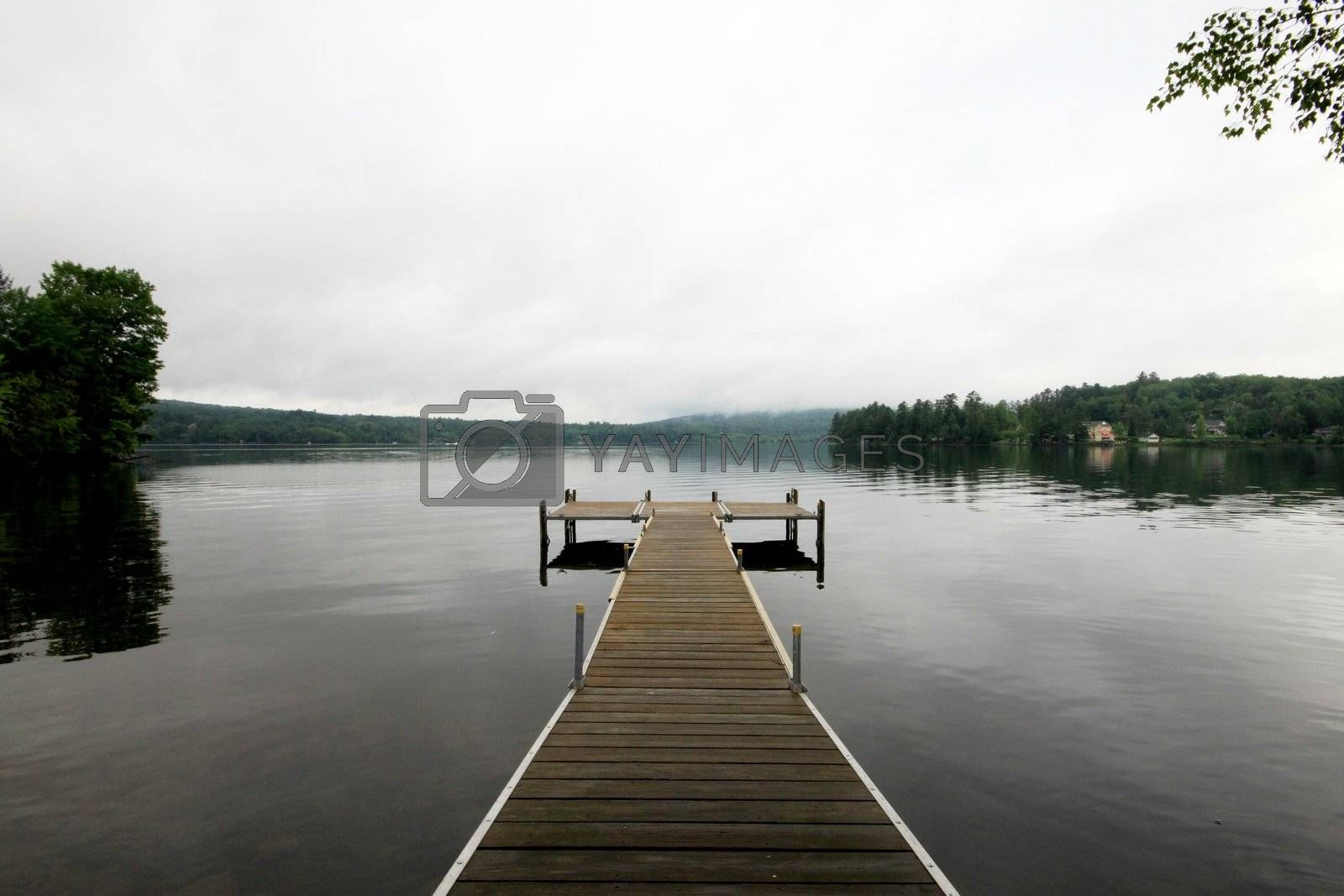 Lake side deck in early morning calm waters