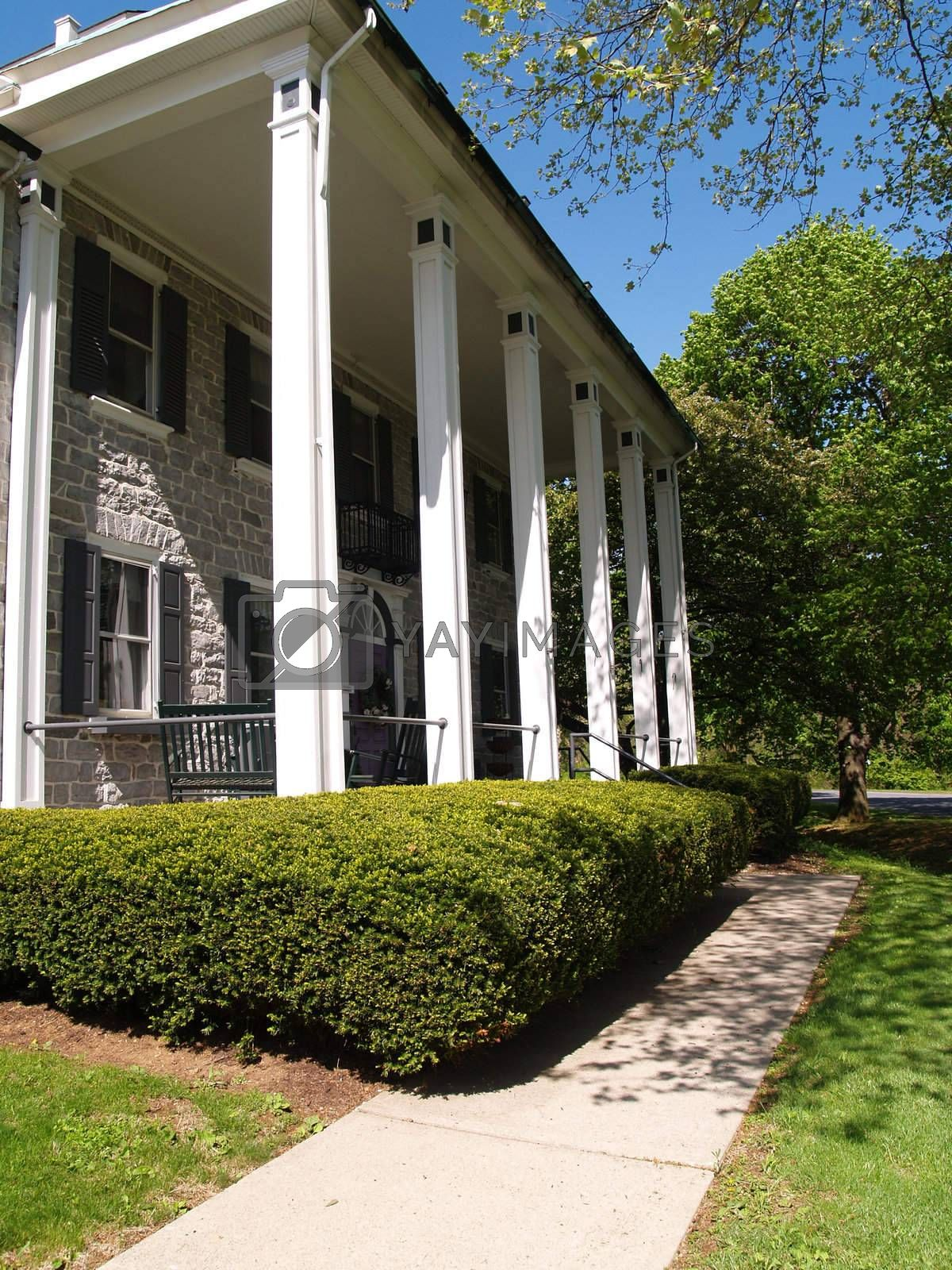 a large front porch with columns