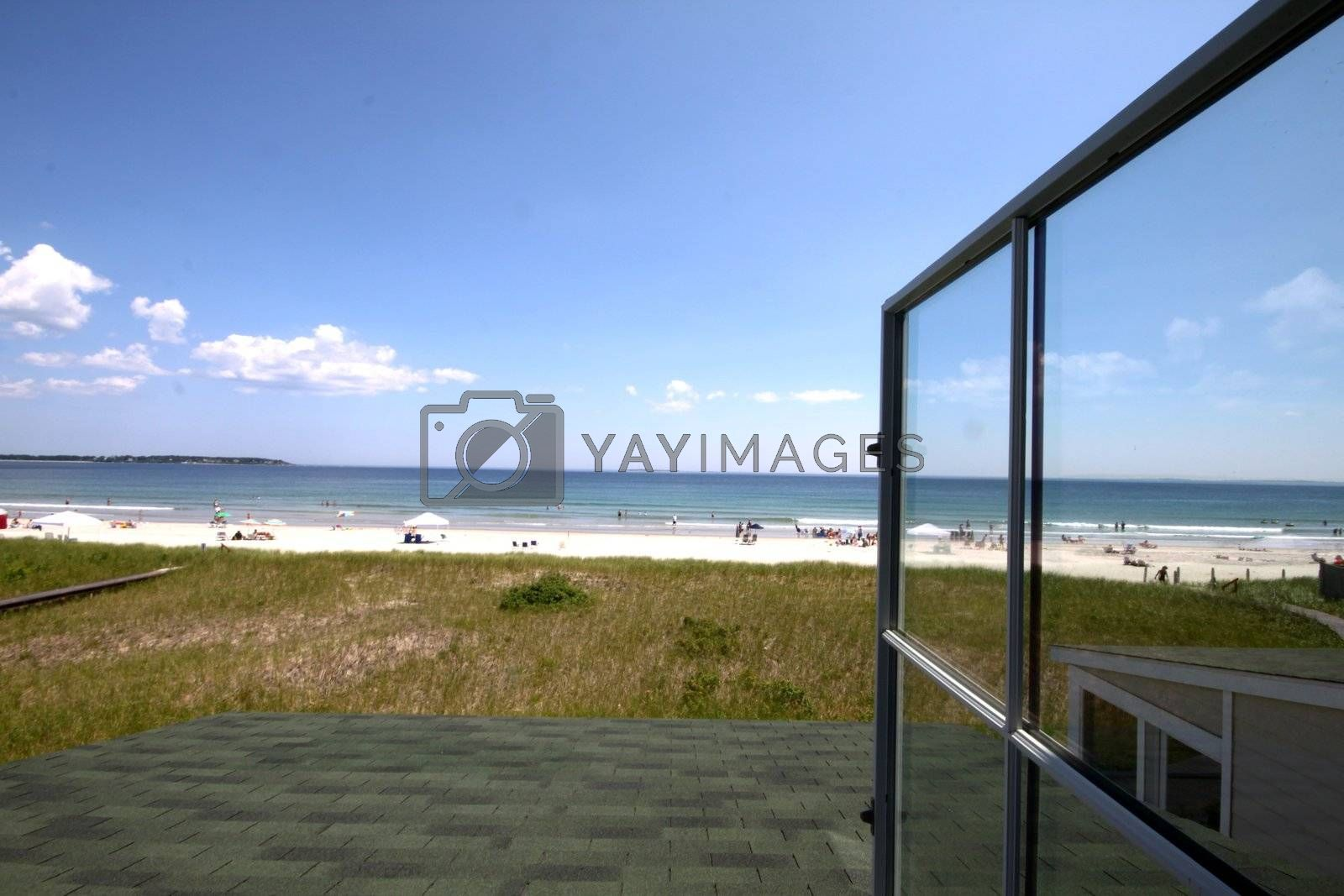 Ocean view from open window in beach front house