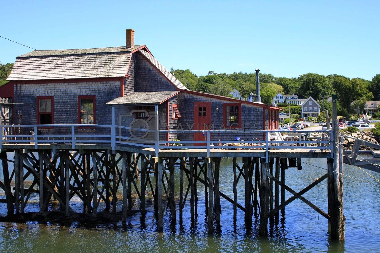 Beach house on stilts near ocean wharf