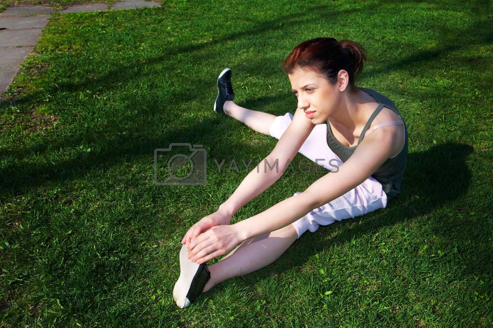 Royalty free image of Teenage Girl Stretching by Luminis