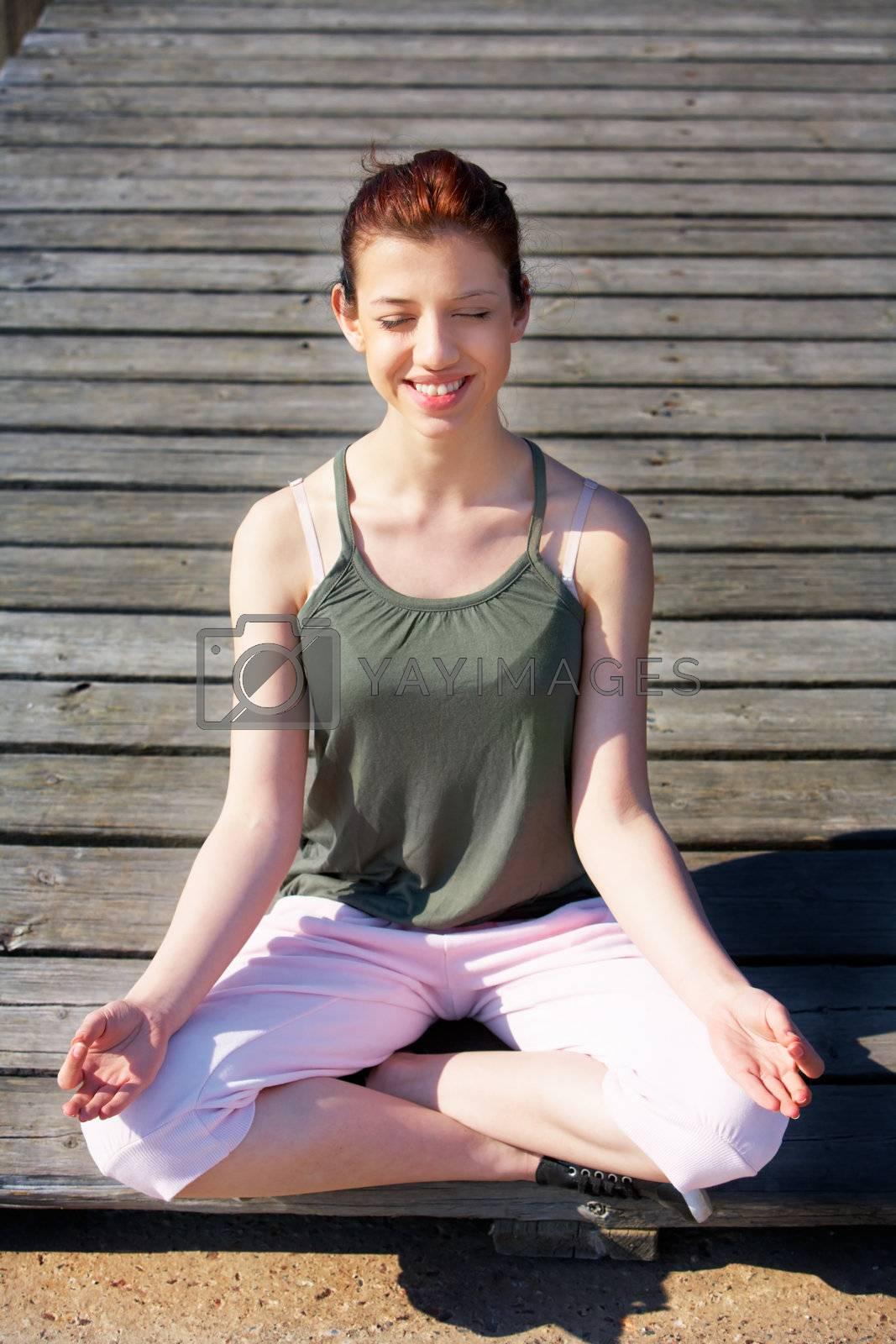 Royalty free image of Teenage Girl Meditating by Luminis