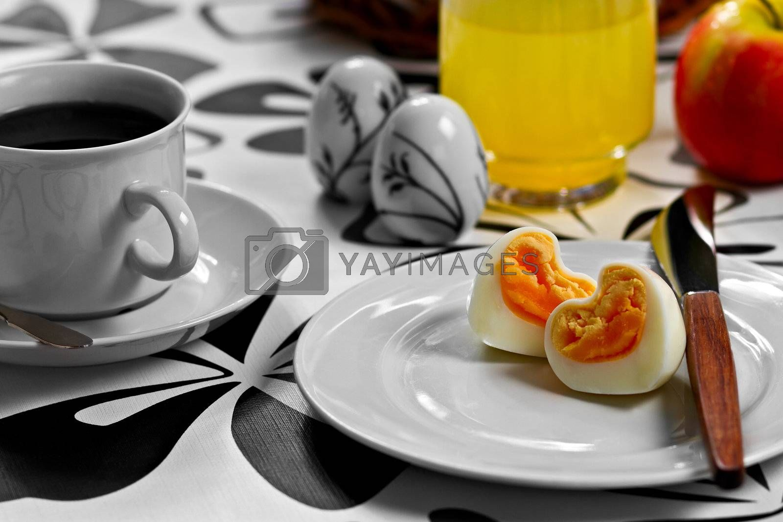 Breakfast with heart shaped egg, coffee, orange juice and an apple