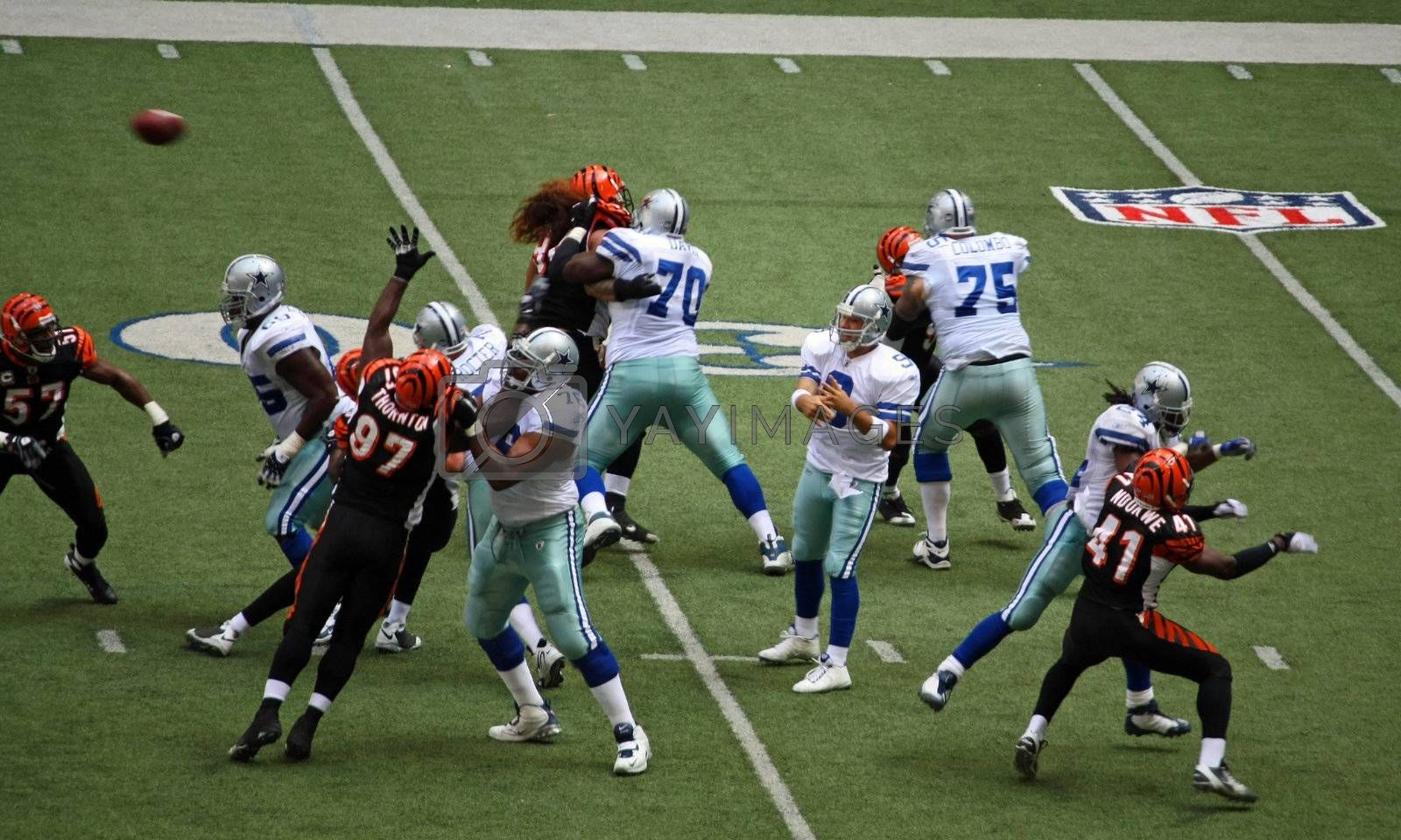 DALLAS - OCT 5: Taken in Texas Stadium in Irving, Texas on Sunday, October 5, 2008. Quarterback Tony Romo is in the pocket thowing a pass down field.