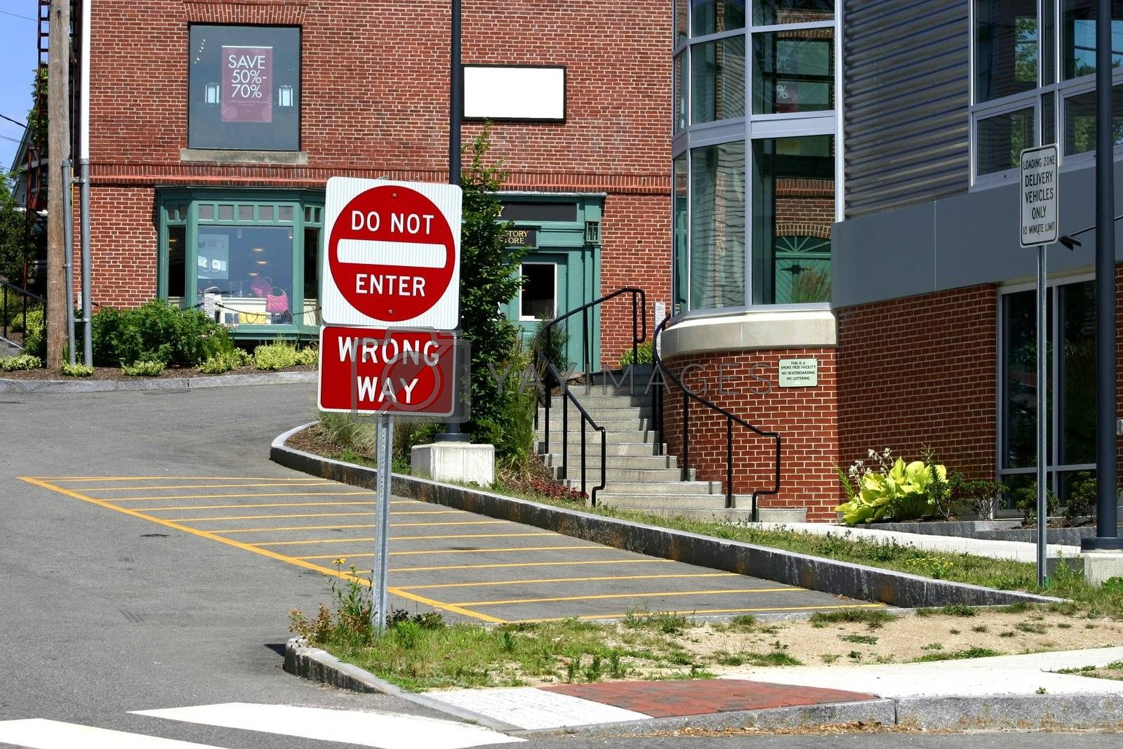 Wrong way sign at a commercial crossing for pedestrians