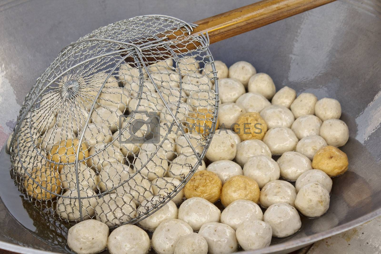 Fish meat ball fry in pan at market of Thailand