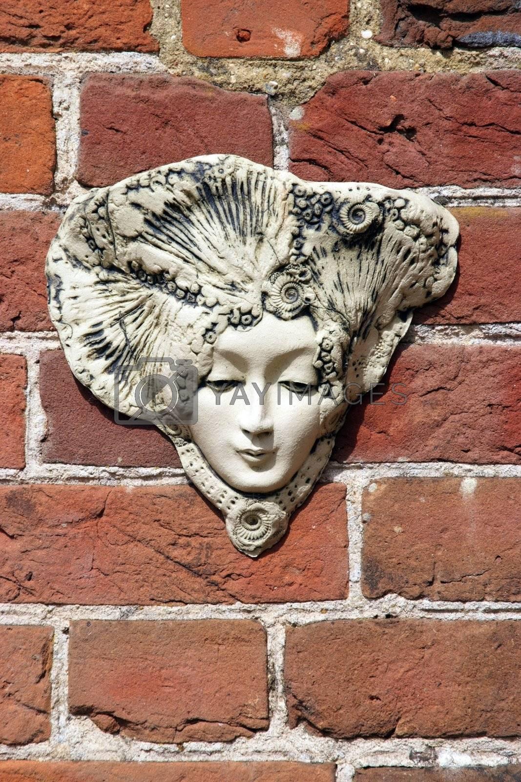 Decorative plant holder on a brick wall