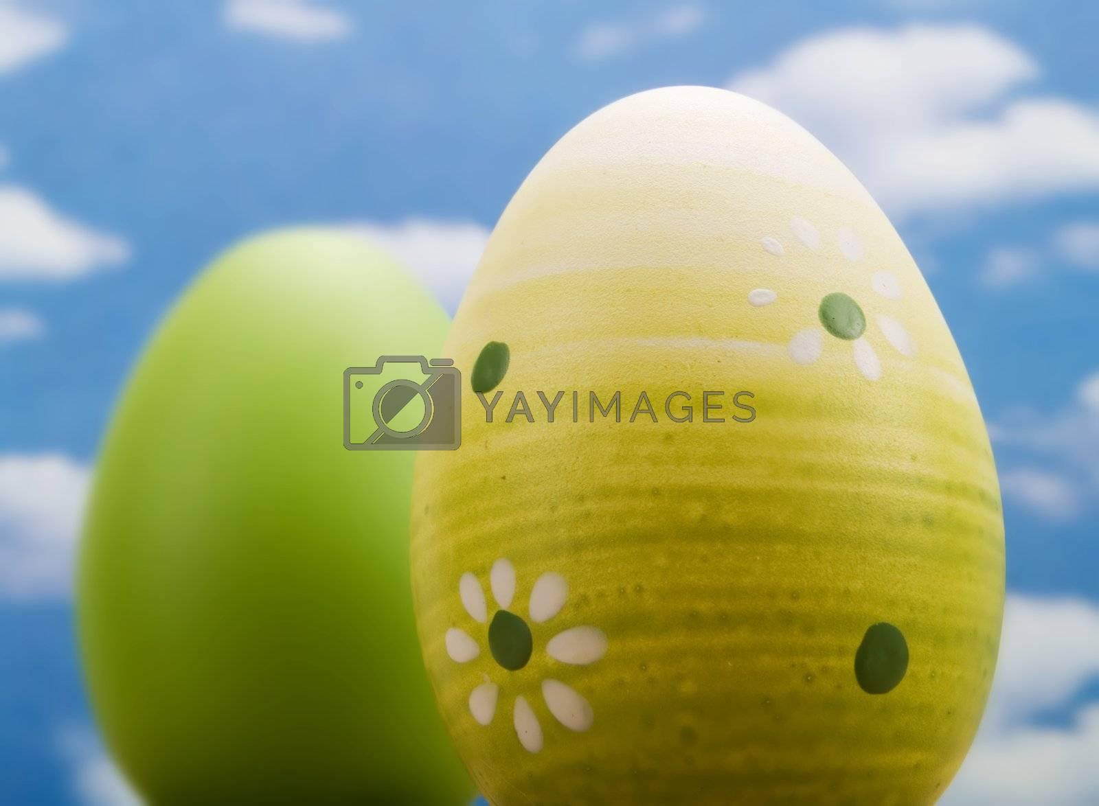 Easter eggs over a blue sky