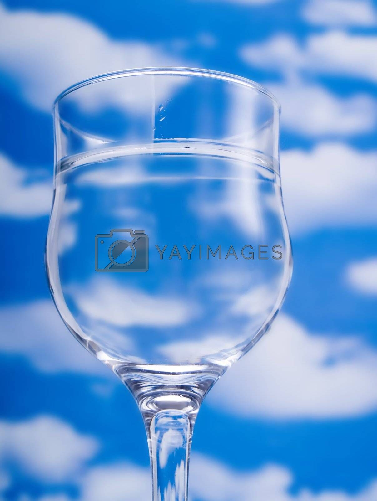Glass of water over a blue sky