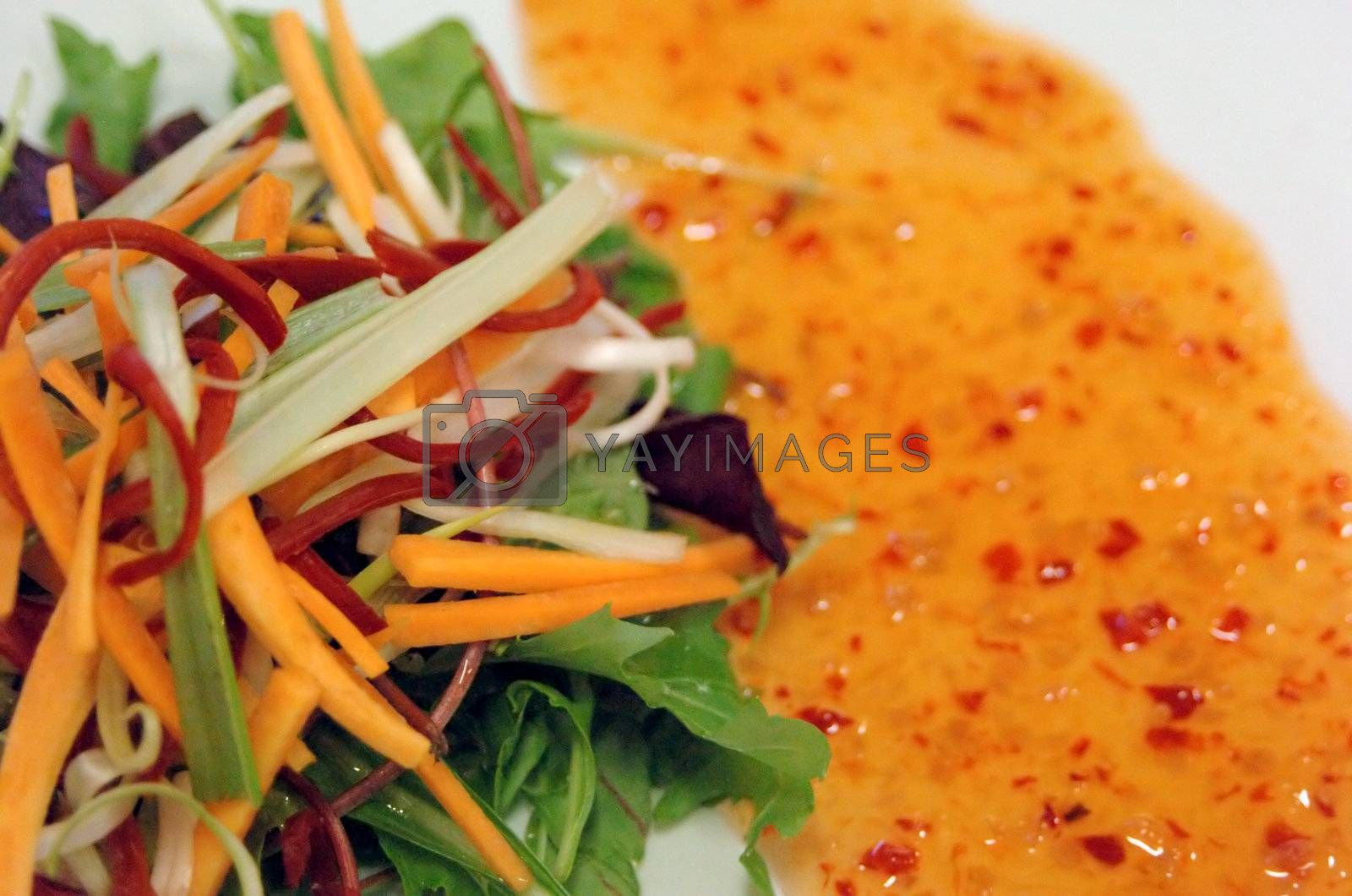 close up of asian salad with sweet chili drizzle