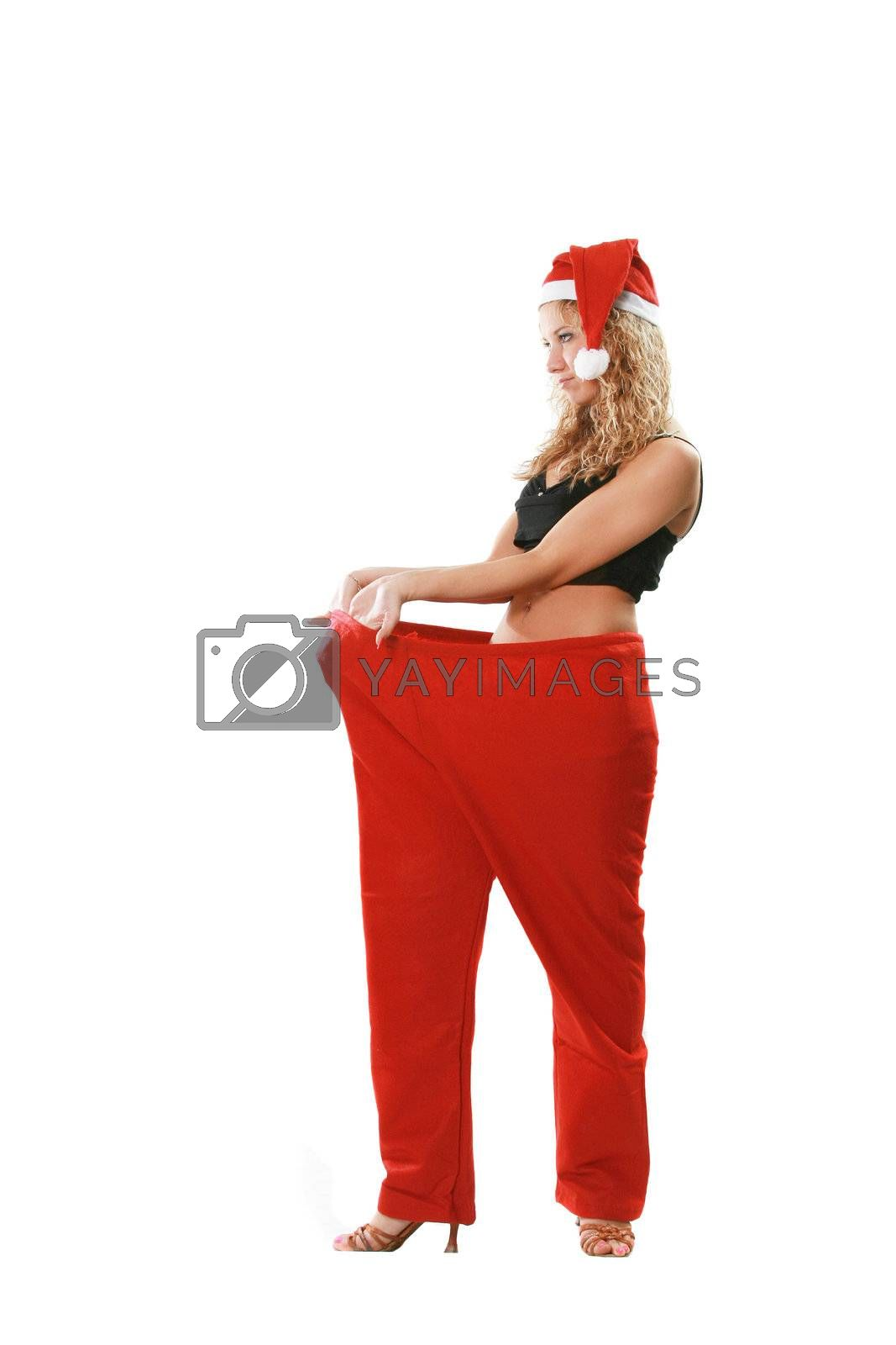The beautiful attractive woman in a suit santa