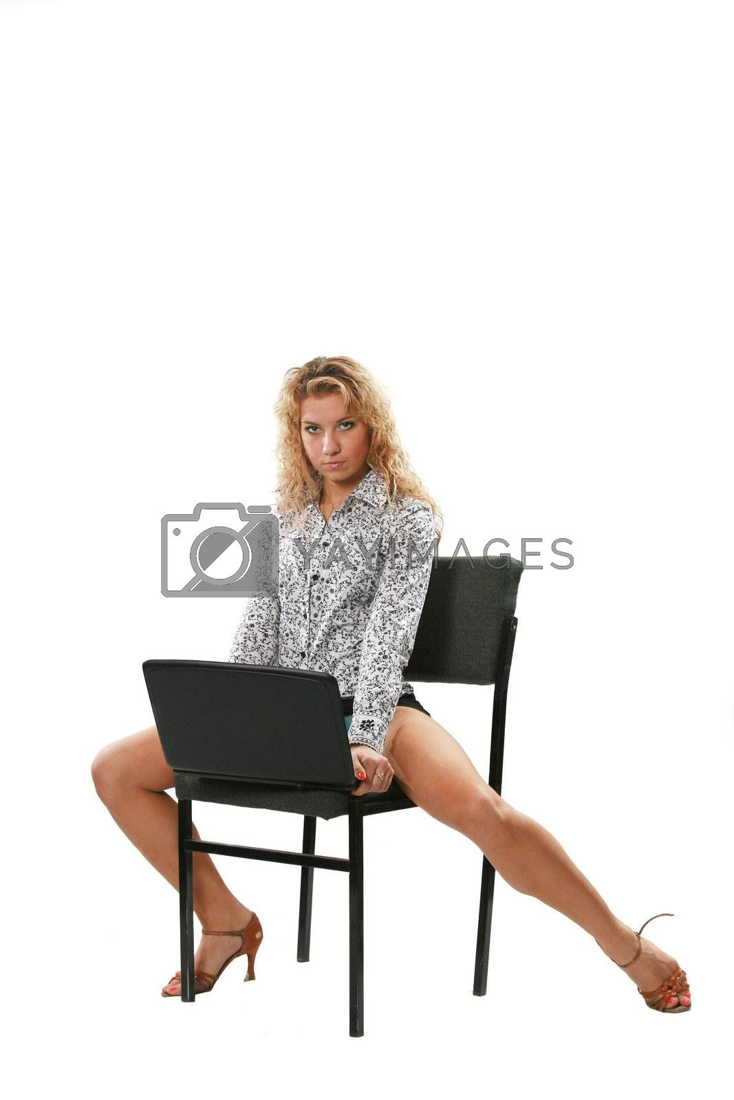 The sexual young woman with laptop on a white background
