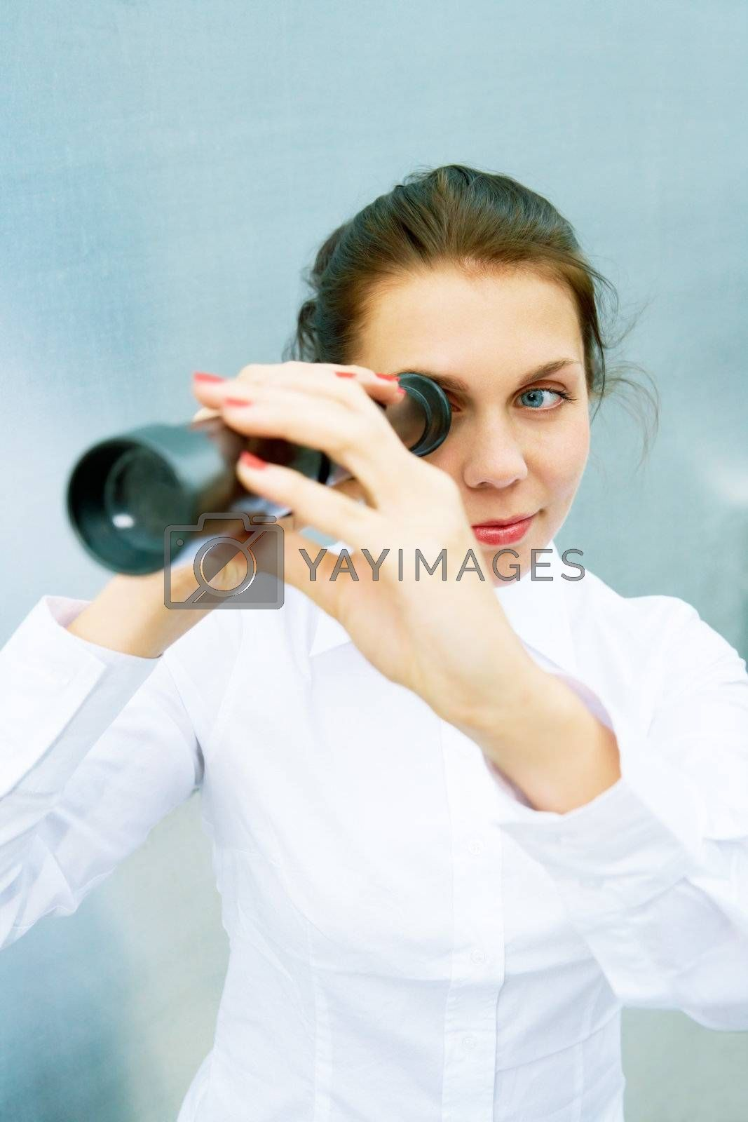 Royalty free image of Young Woman with Telescope by Luminis