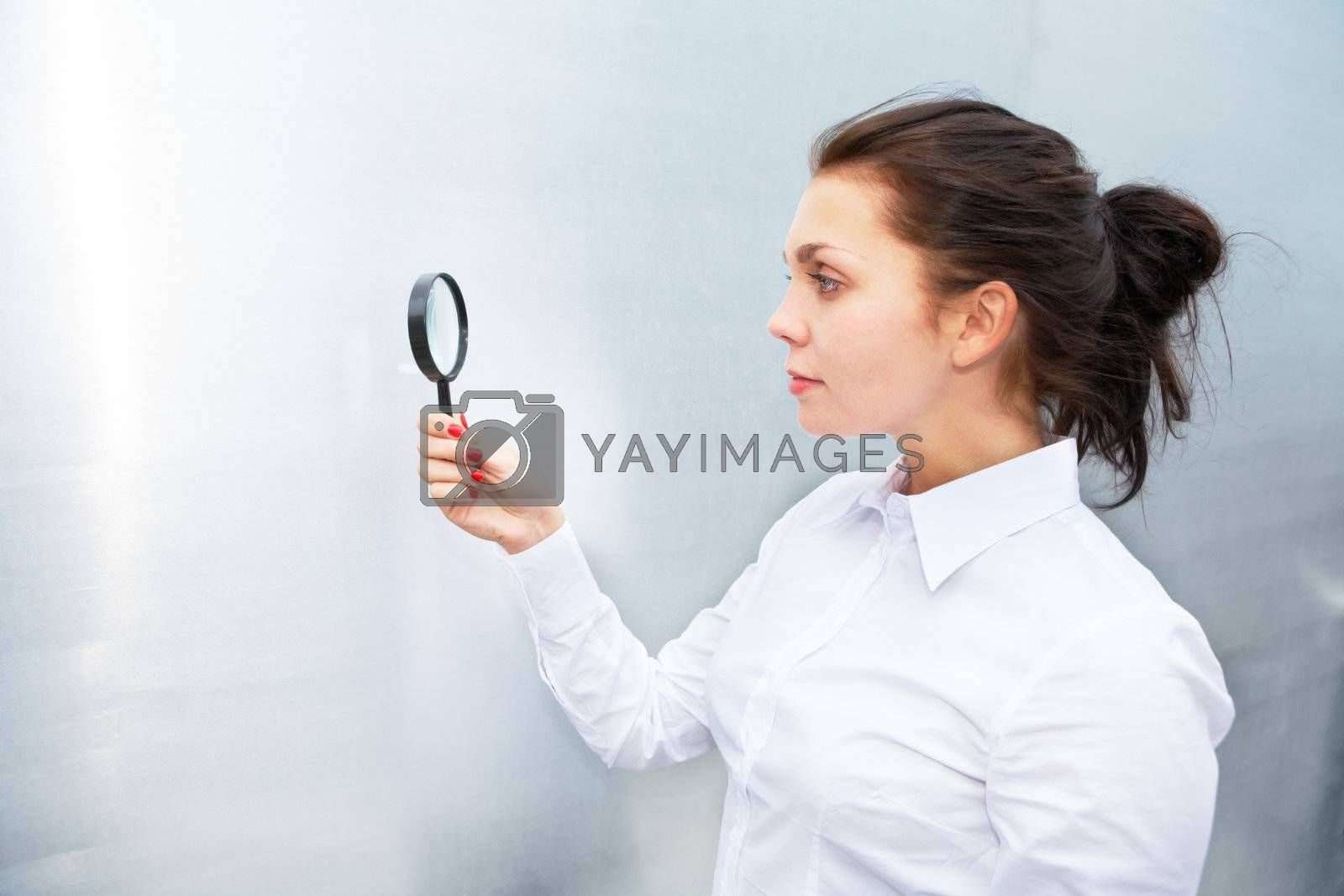 Royalty free image of Using Magnifying Glass by Luminis