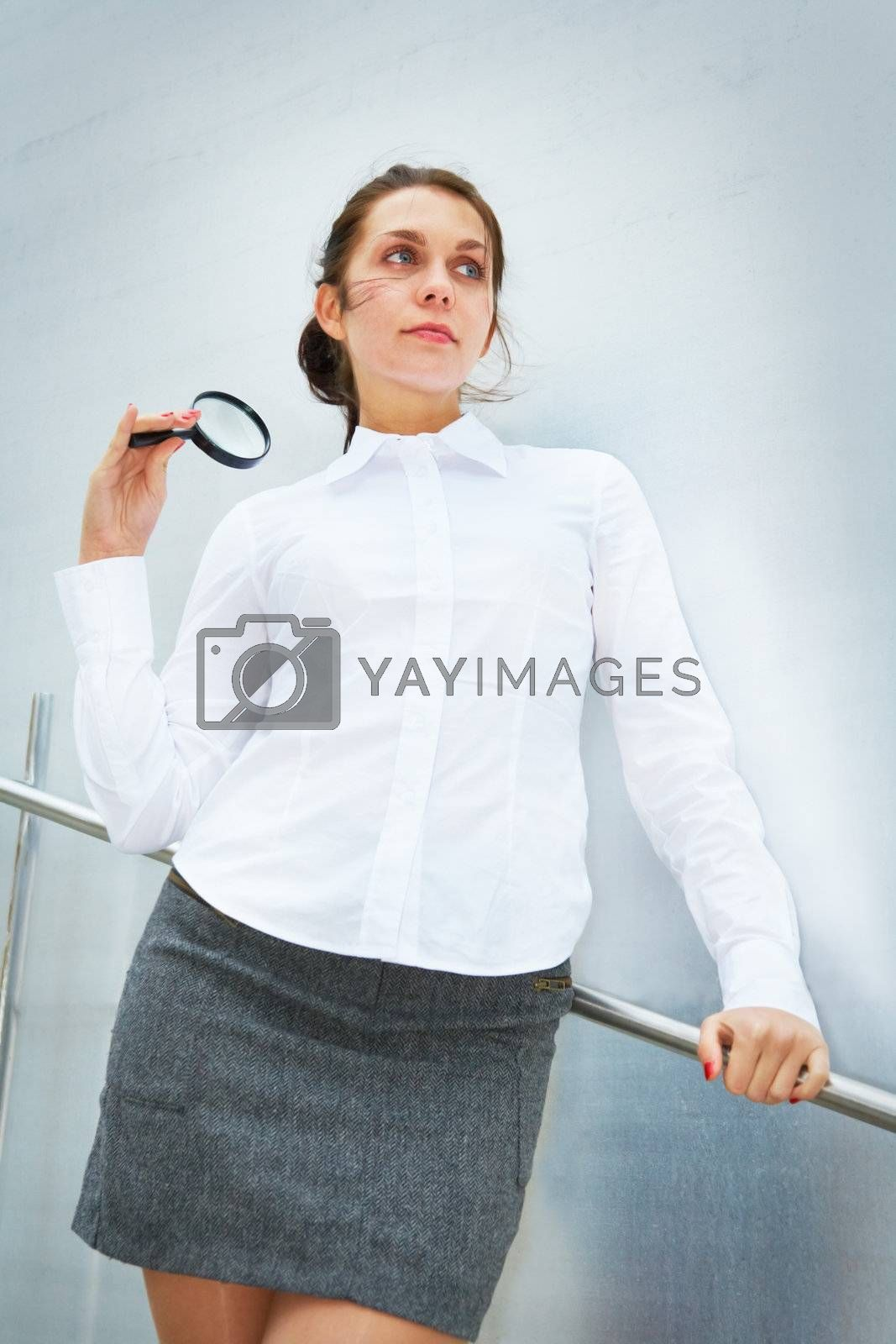 Royalty free image of Young Woman with Magnifying Glass by Luminis