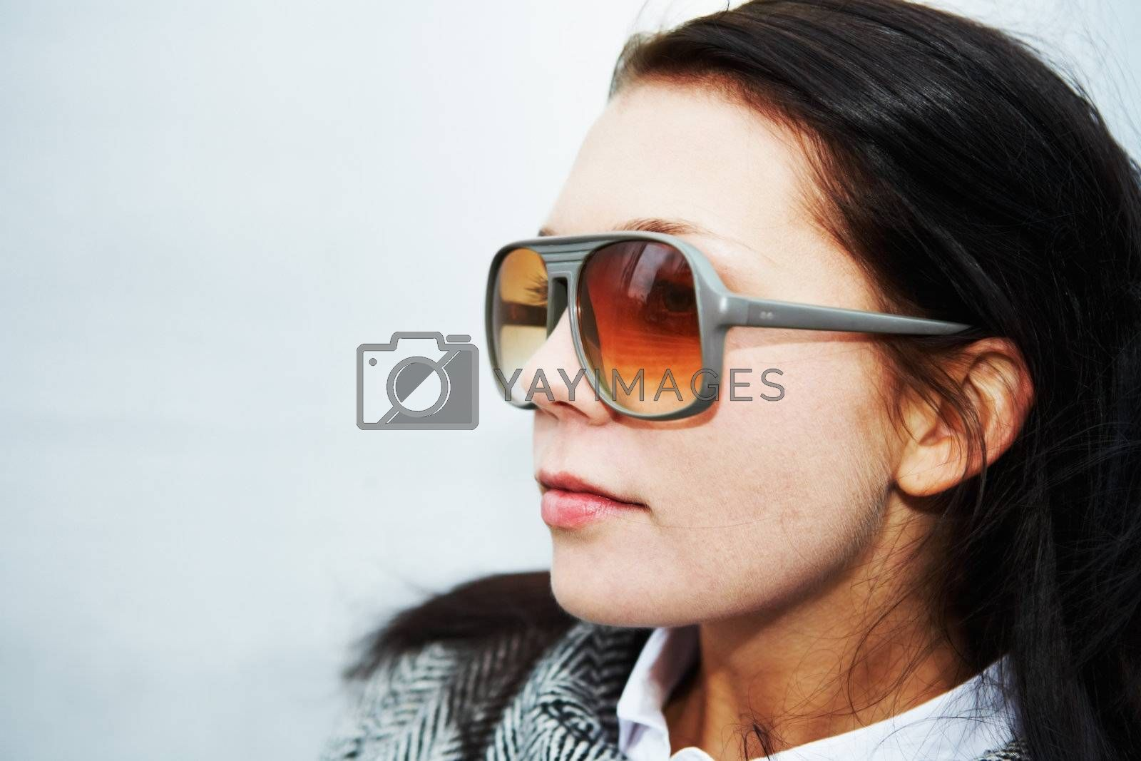 Royalty free image of Woman Wearing Sunglasses by Luminis