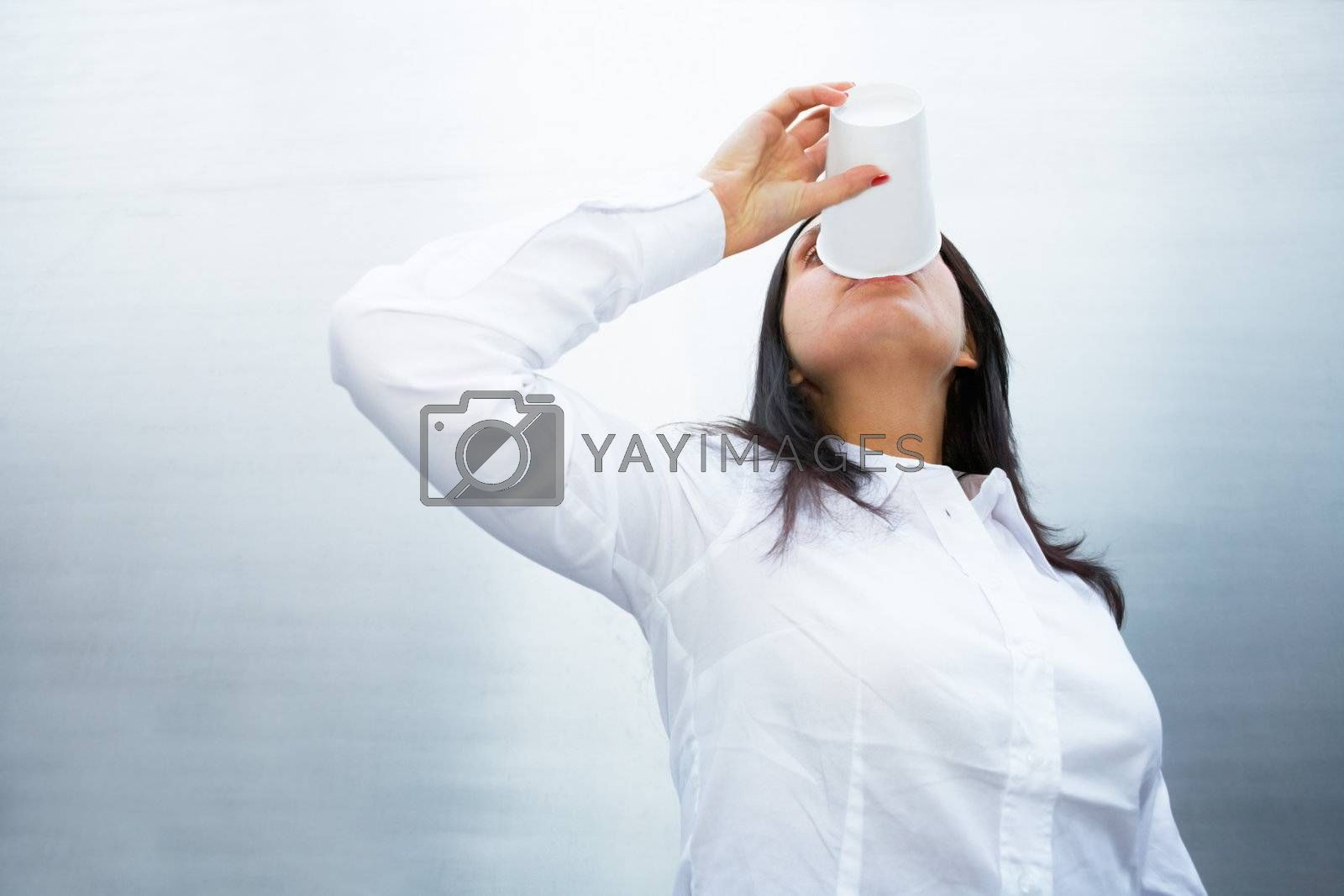 Royalty free image of Woman Drinking Coffee by Luminis