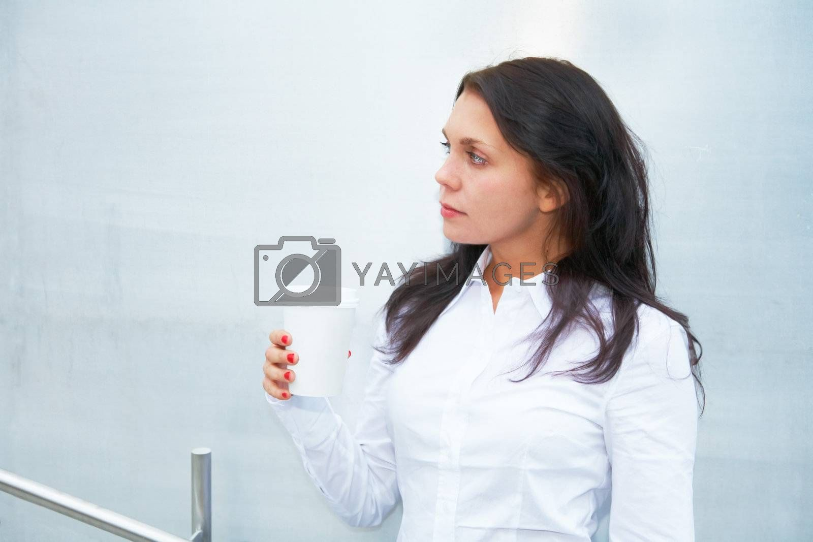 Royalty free image of Young Woman with Coffee by Luminis