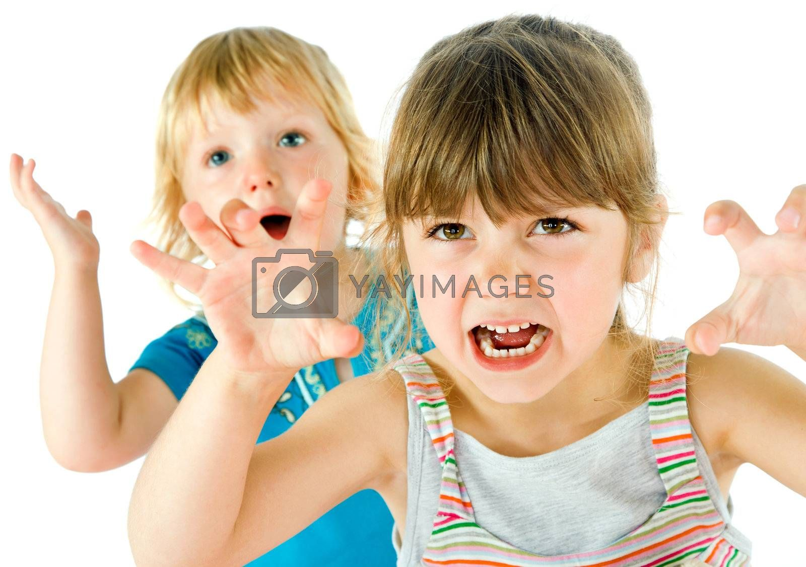 Portrait of two little kids playing, making scary grimaces  isolated on white