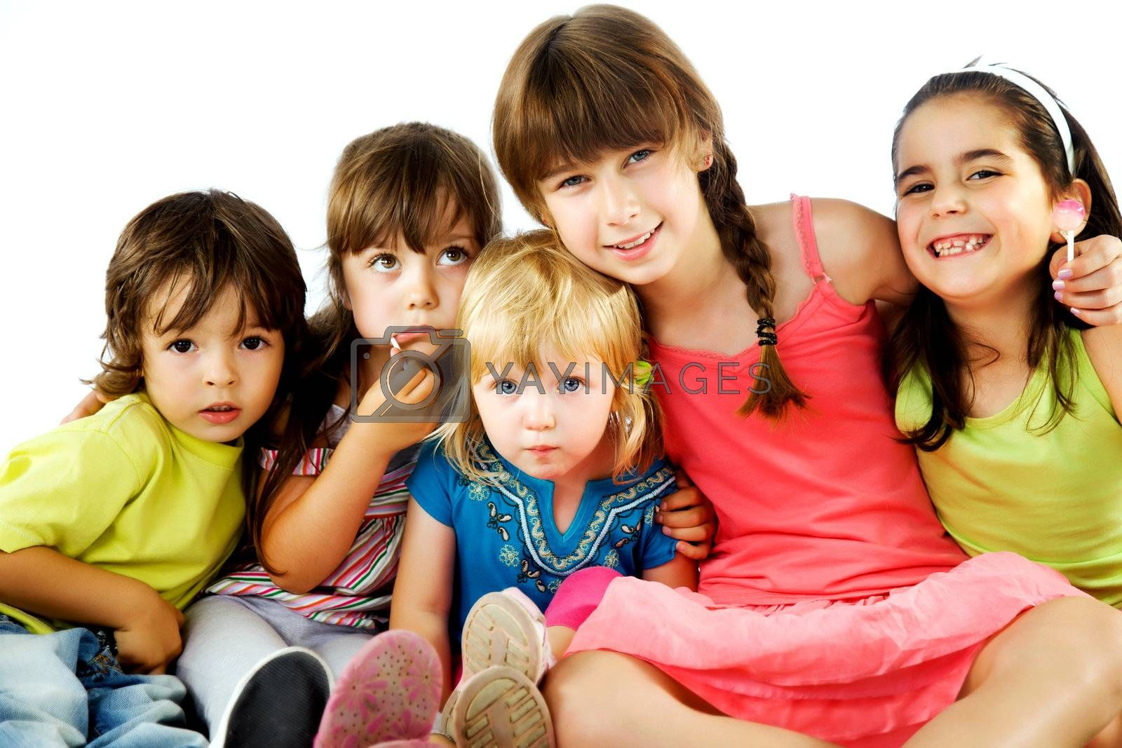 Group of five little kids sitting smiling and hugging, isolated on white