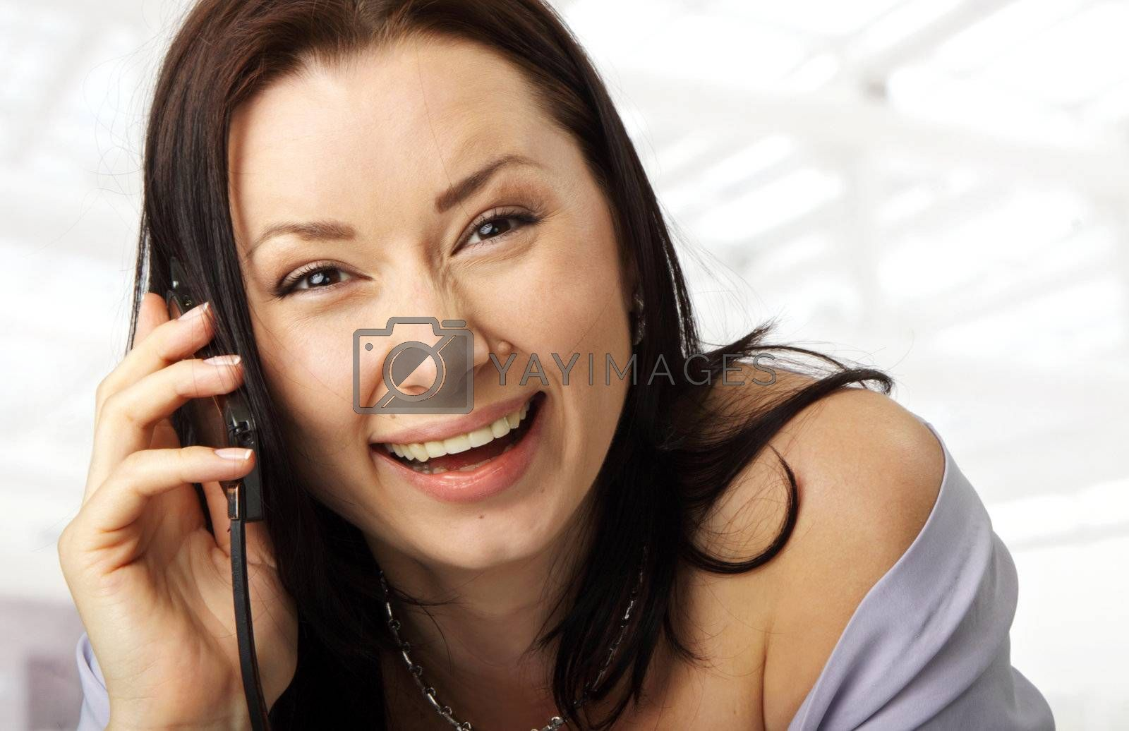 close-up of a happy female face with a cellphone