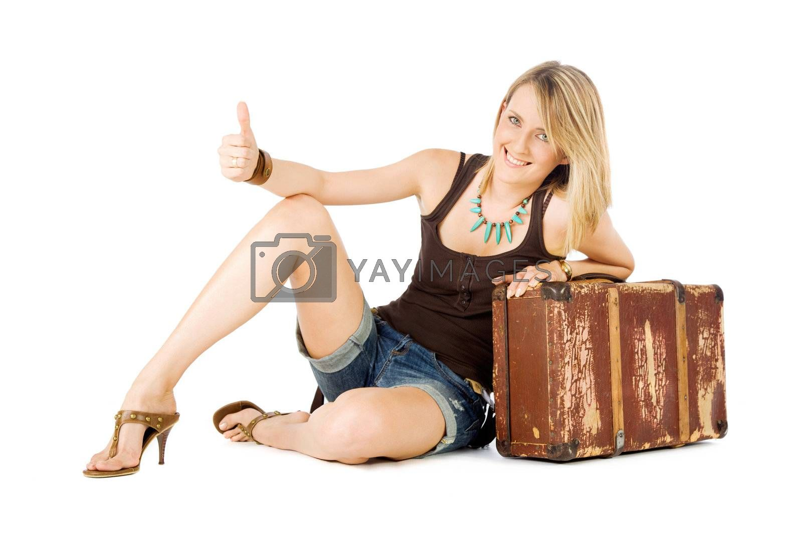 Happy casual woman leaning on an old suitcase  hitchhiking, isolated on white